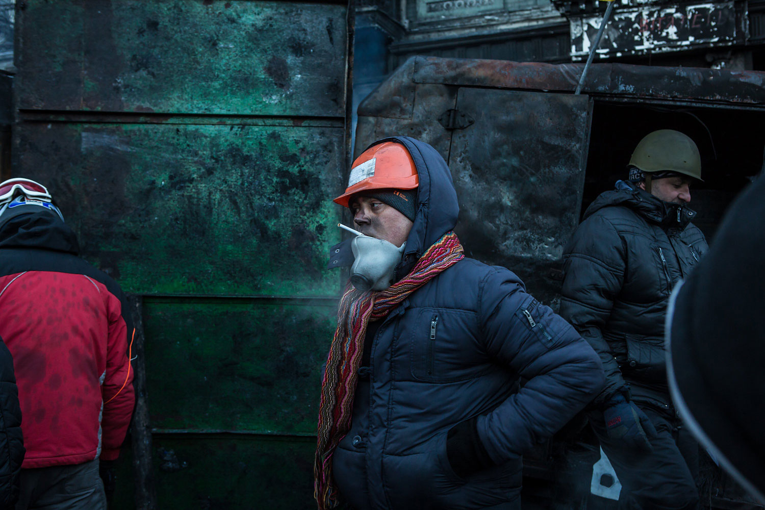 Anti-government protesters guard a barricade on a street near Dynamo stadium on Jan. 24, 2014 in Kiev.