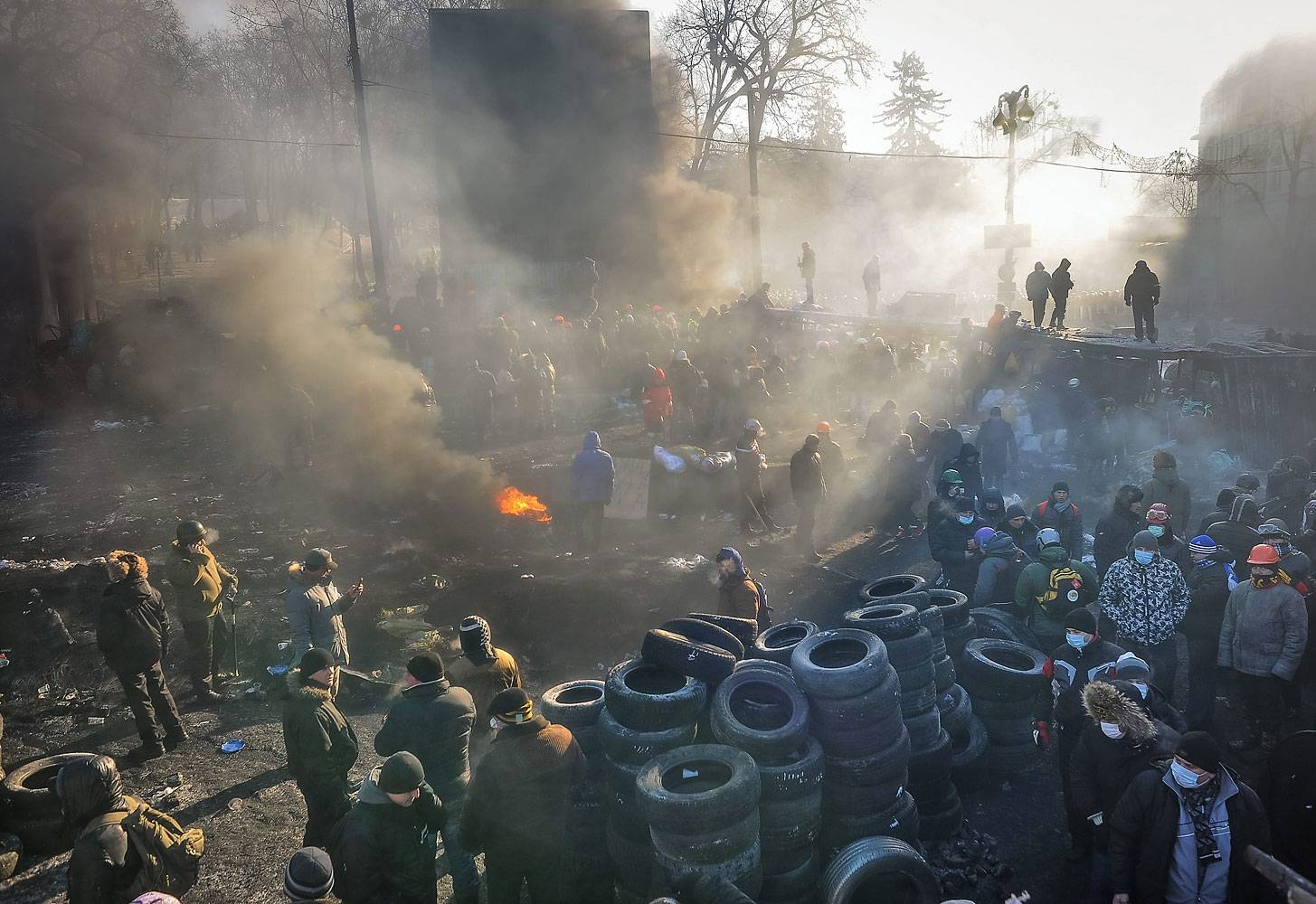 Ukrainians gather at a barricade during continuous anti-government protests in Kiev, Jan. 24,  2014.