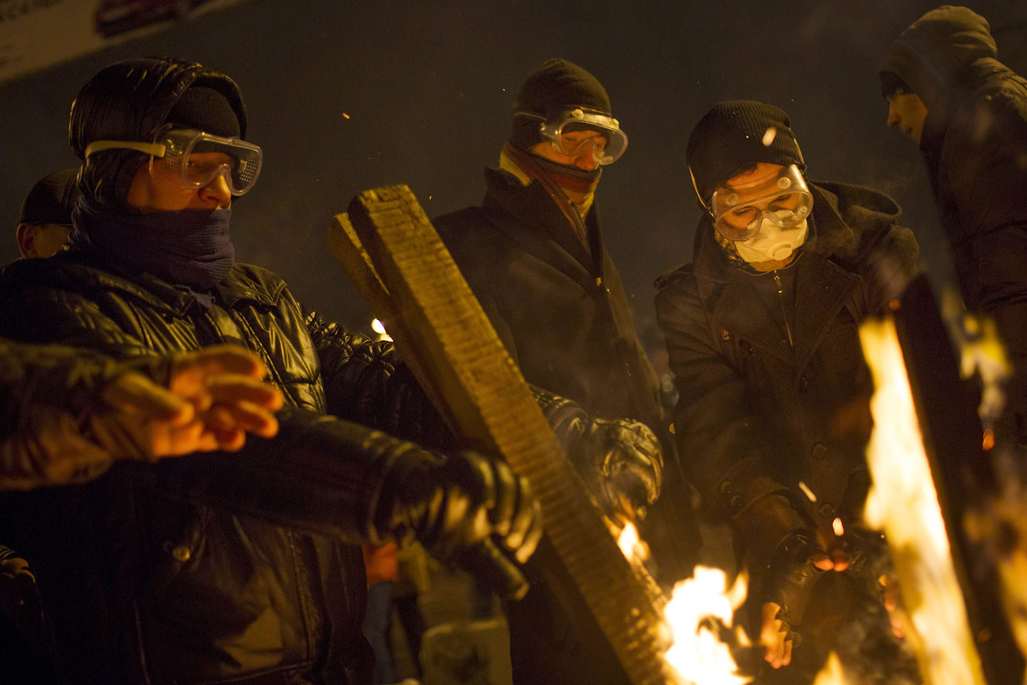 Protestors gather around a fire during a stand off with police on Jan. 23, 2014 in Kiev.