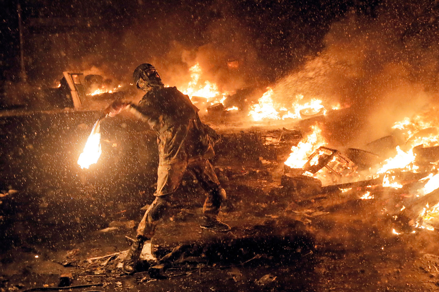 A protester throws a Molotov cocktail during clashes with police in central Kiev, Jan. 22, 2014.