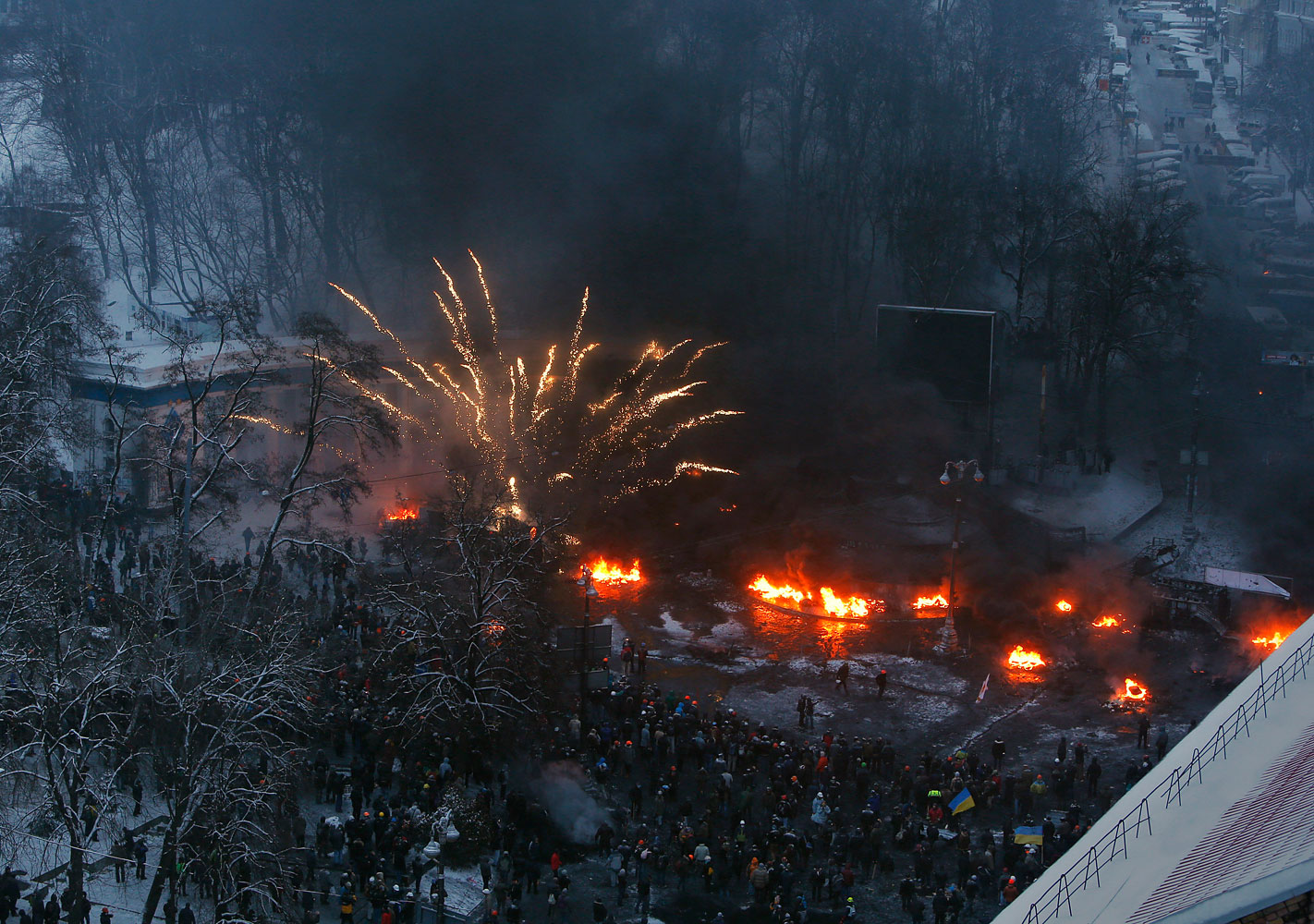 Tires burn in the street, set alight by protesters in clashes with police in central Kiev, Jan. 22, 2014.