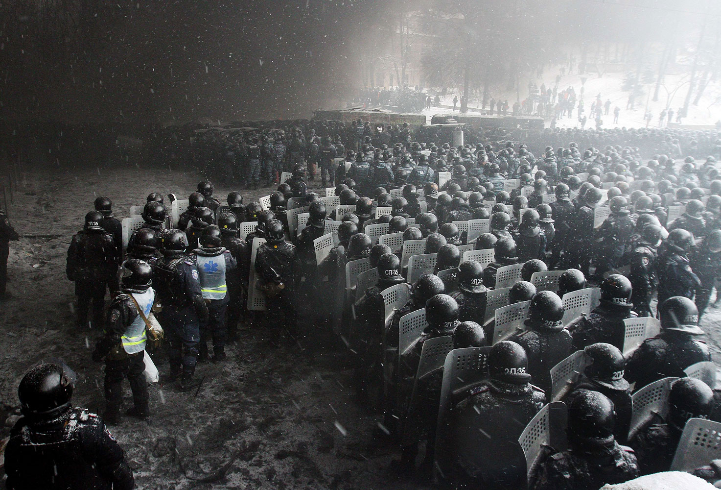 Riot police officers gather as they clash with protestors in the center of Kiev on Jan. 22, 2014.
