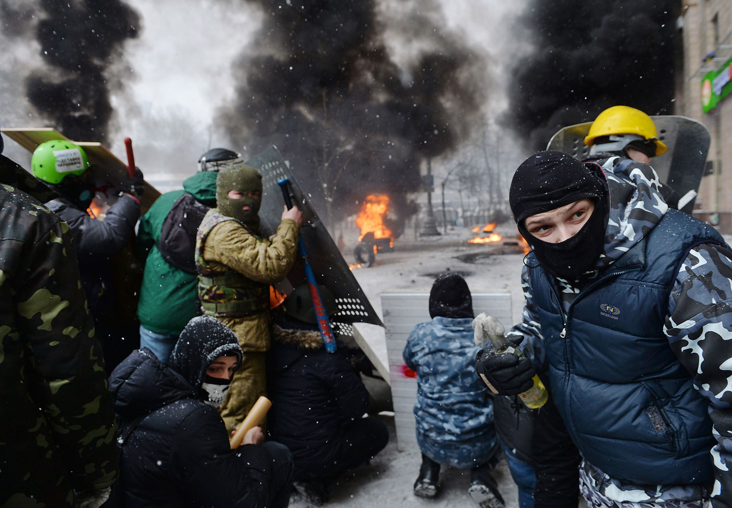 A demonstrator holds an incendiary device as protesters clash with police in the center of Kiev on Jan. 22, 2014.