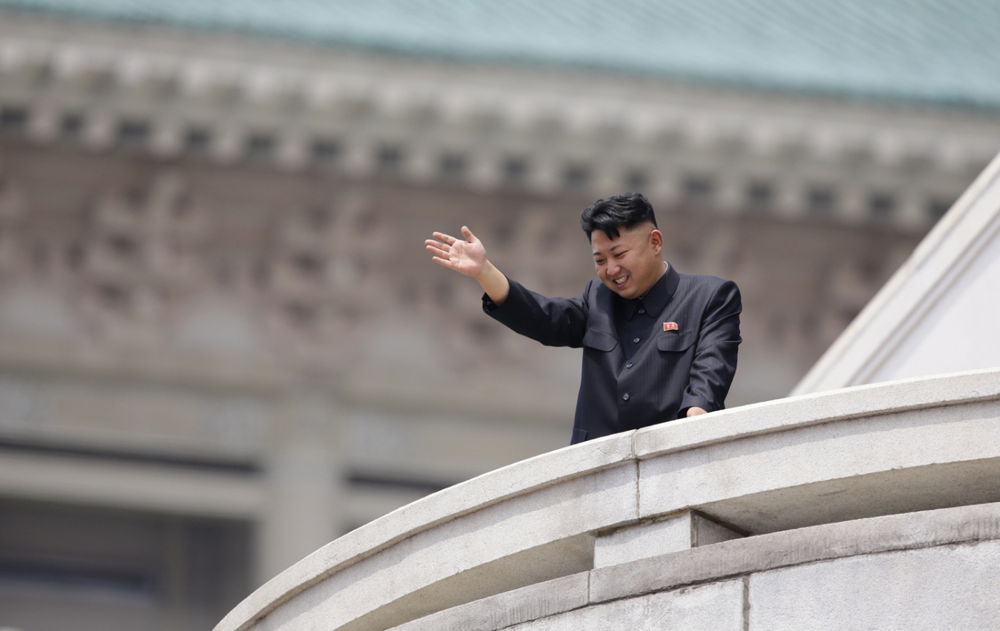 North Korean leader Kim Jong-un waves to the people during a parade to commemorate the 60th anniversary of the signing of a truce in the 1950-1953 Korean War, at Kim Il-sung Square in Pyongyang July 27, 2013.