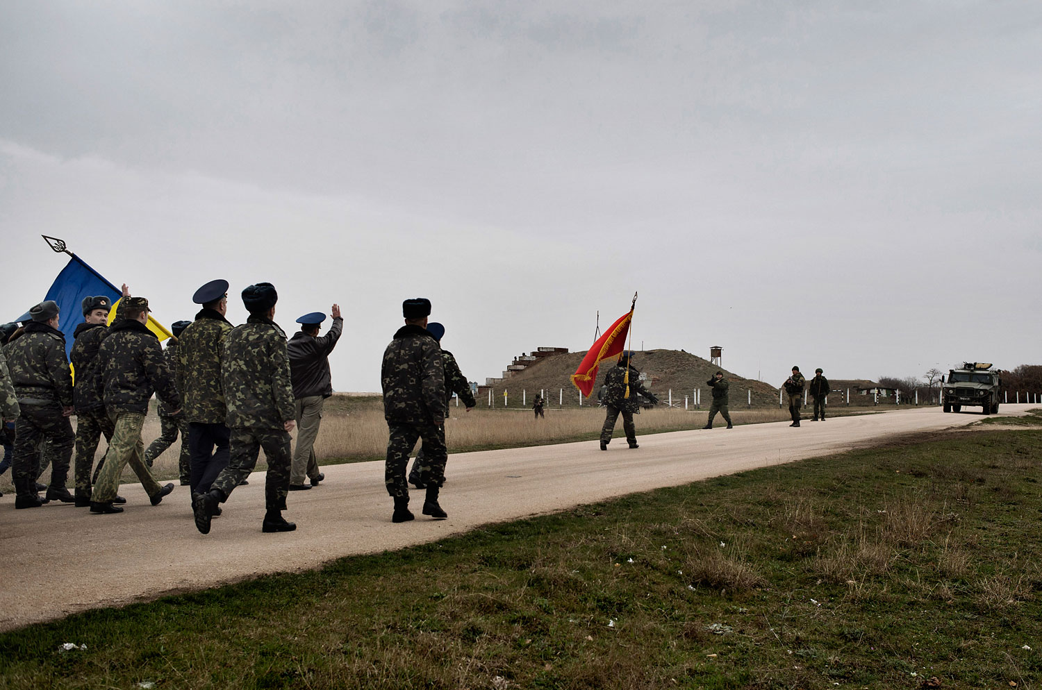 Unarmed Ukrainian soldiers approach Russian positions on the perimeter of the contested Belbek air force base in Crimea, March 4, 2014.