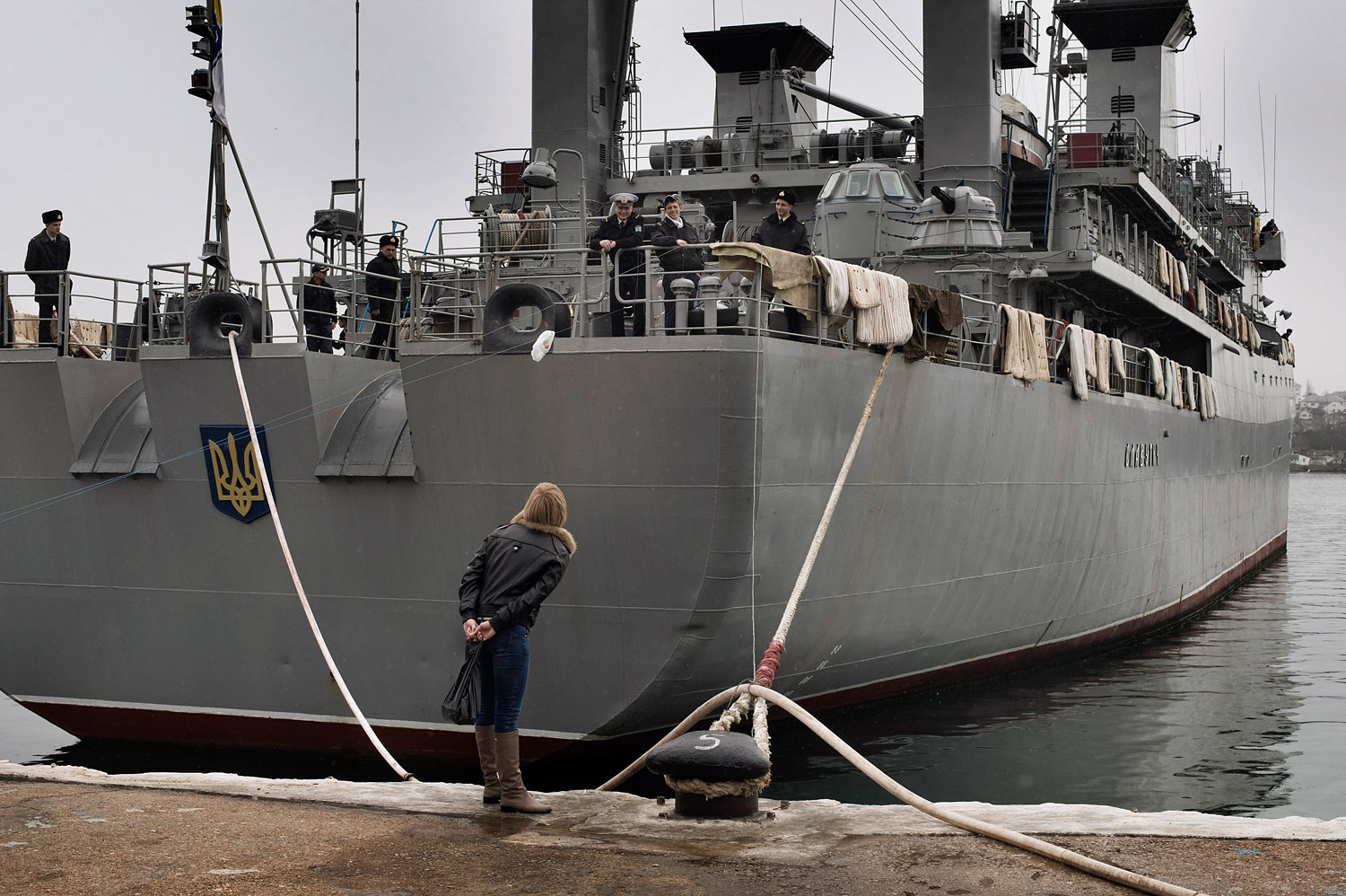 Ukrainian sailors, on a ship blocked by Russian forces, spoke to their relatives at the port of Sevastopol, March 4, 2014.