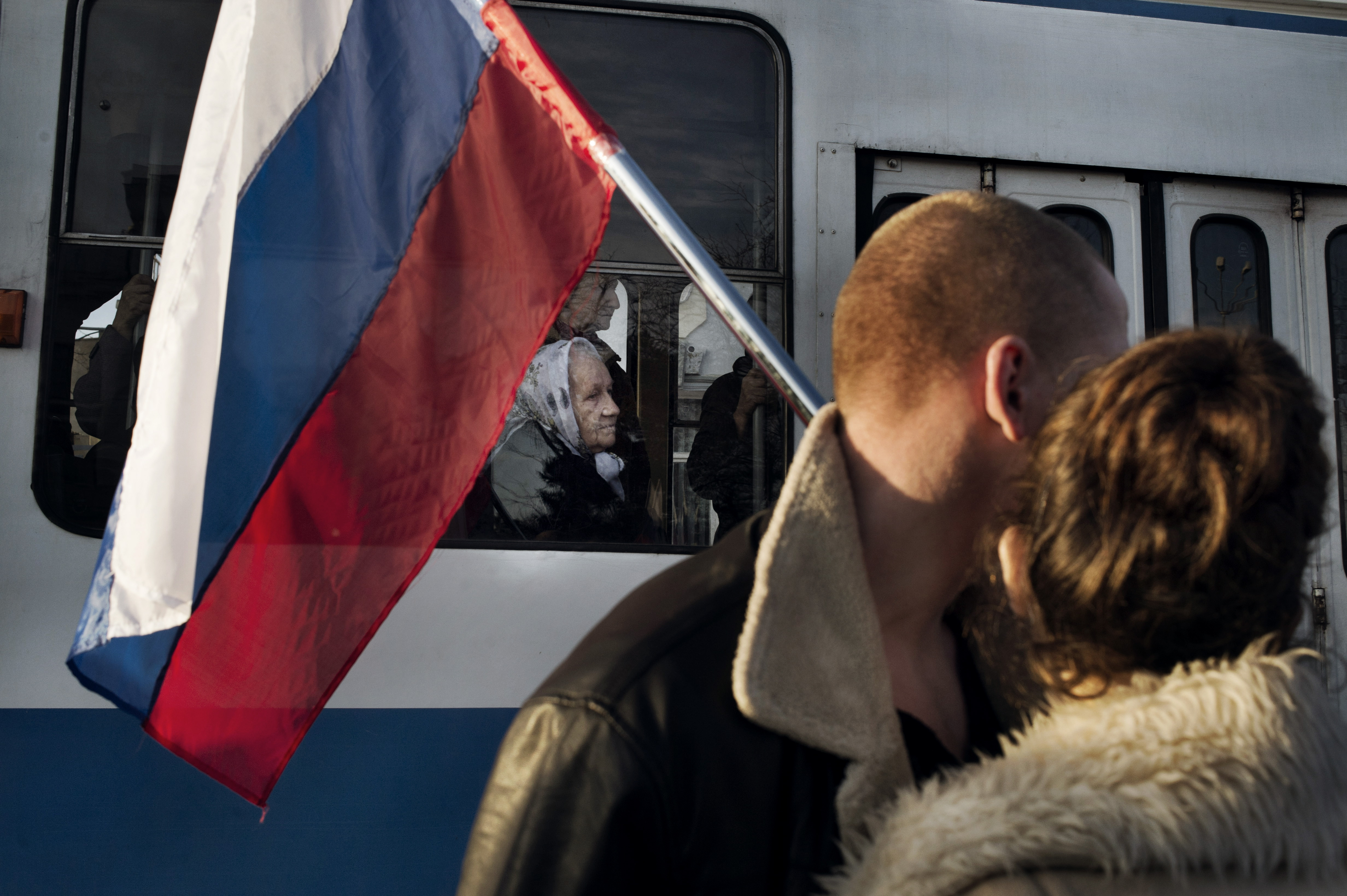 Woman watches a pro-Russian gathering in Yevpatoria, Ukraine, March 5, 2014.