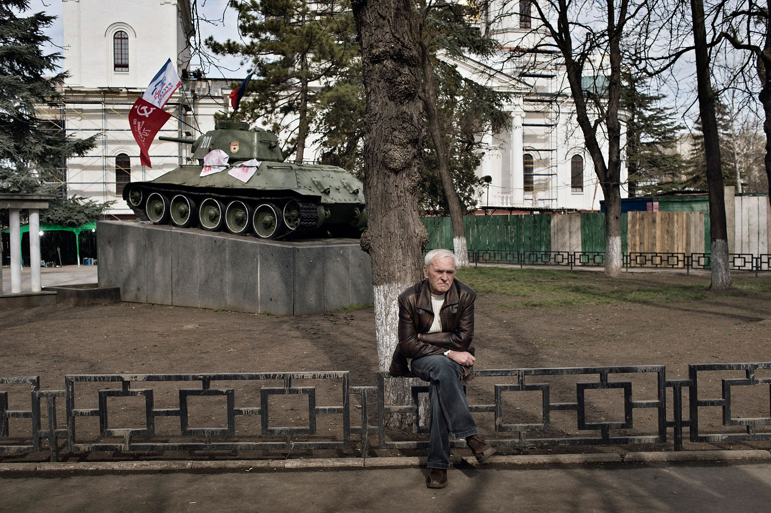 Man watches a pro-Russian rally near the local parliament building in Crimea's capital Simferopol, March 6, 2014.