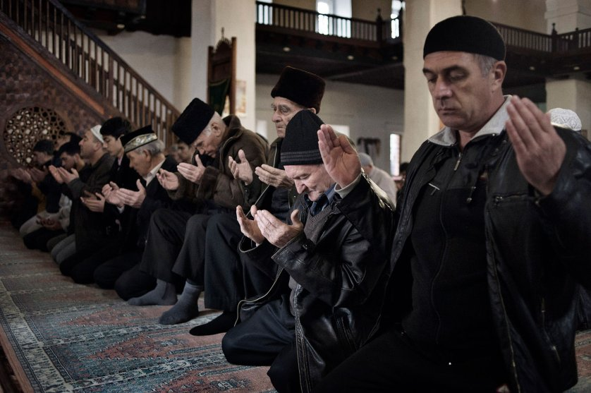 Ethnic Crimean Tatars pray at The Big Khan Mosque in Bakhchysaray, March 6, 2014.