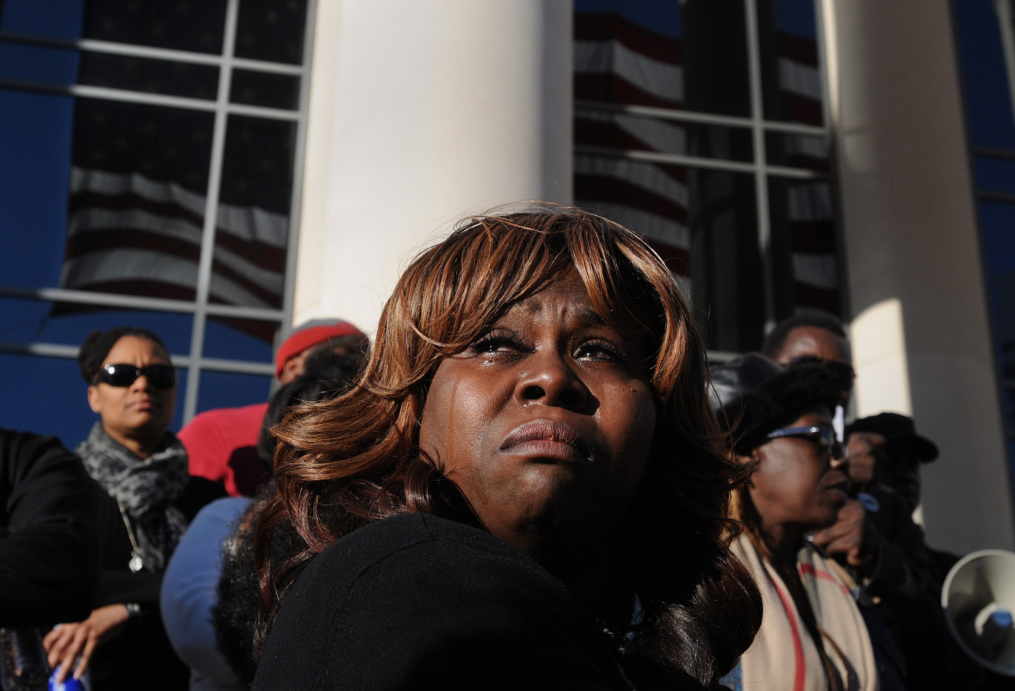 Denise Hunt tears up as she finds out the jury is deadlocked on the first-degree murder charge for Michael Dunn outside of the Duval County Courthouse as the jury enters the fourth day of deliberations, Feb. 15, 2014, in Jacksonville, Fla.