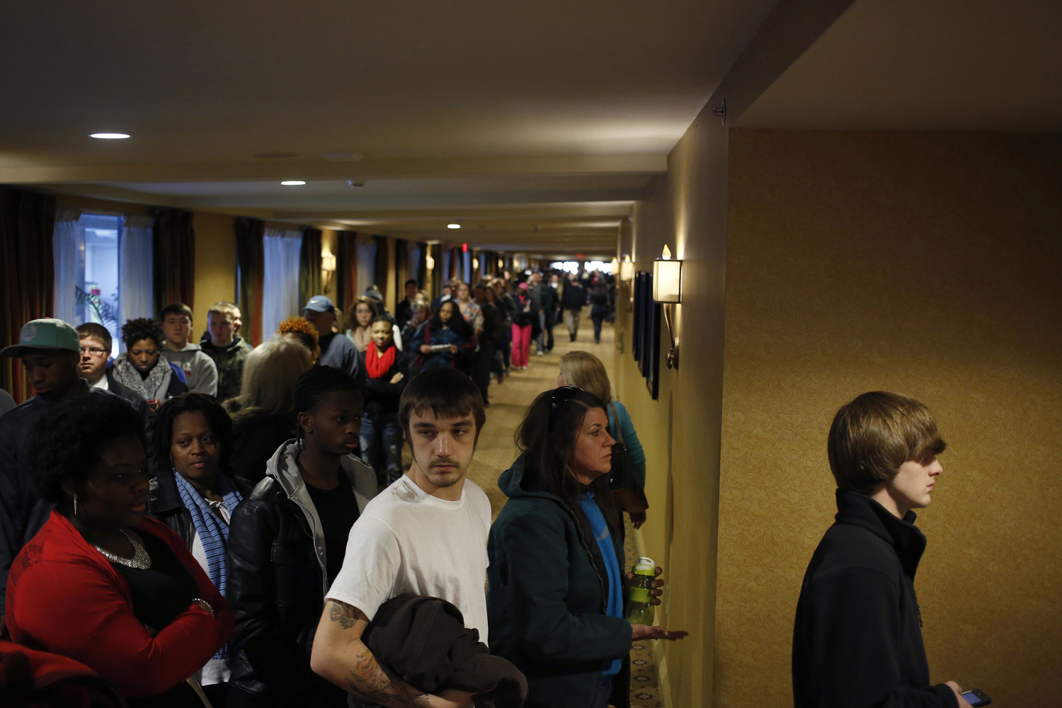 Prospective job applicants wait in line to learn about job openings at the Kentucky Kingdom Amusement Park during a job fair at the nearby Crowne Plaza Hotel in Louisville, Ky., Jan. 4, 2013.