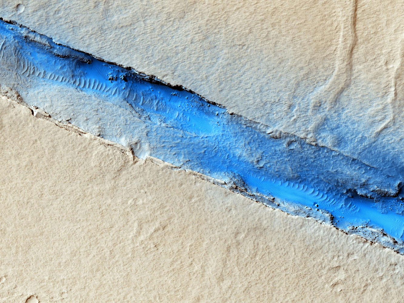 A fissure near Mars's Cerberus Fossae is captured in this image released on Jan. 15, 2014. The picture was taken by the Mars Reconnaissance Orbiter.