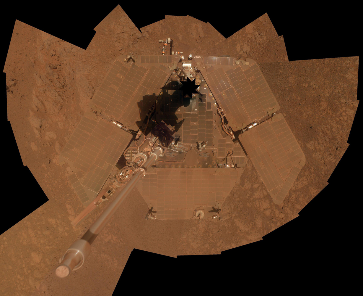 NASA's Mars rover Opportunity took this self-portrait, a mosaic of images, about three weeks before completing a decade of work on Mars in January 2014. The rover's panoramic camera took the images during the interval January 3, 2014, to January 6, 2014, a few days after winds removed some of the dust that had been accumulating on its solar panels.