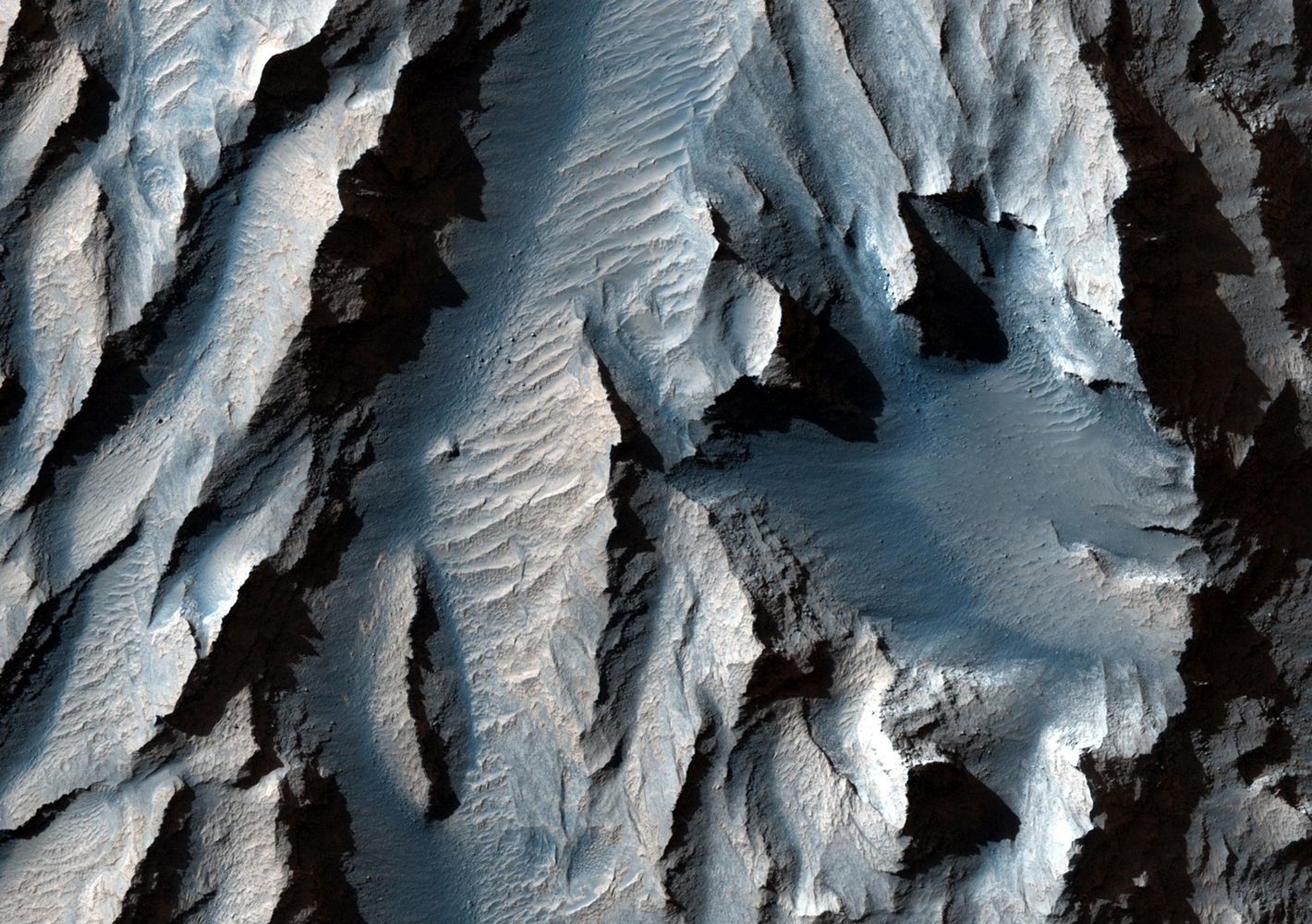 An east-facing slope in Mars's Tithonium Chasma, obtained Jan. 10, 2014, showing sediment layers of near-uniform thickness. The layers are the dark and light stripes that run diagonally across the center of the picture.