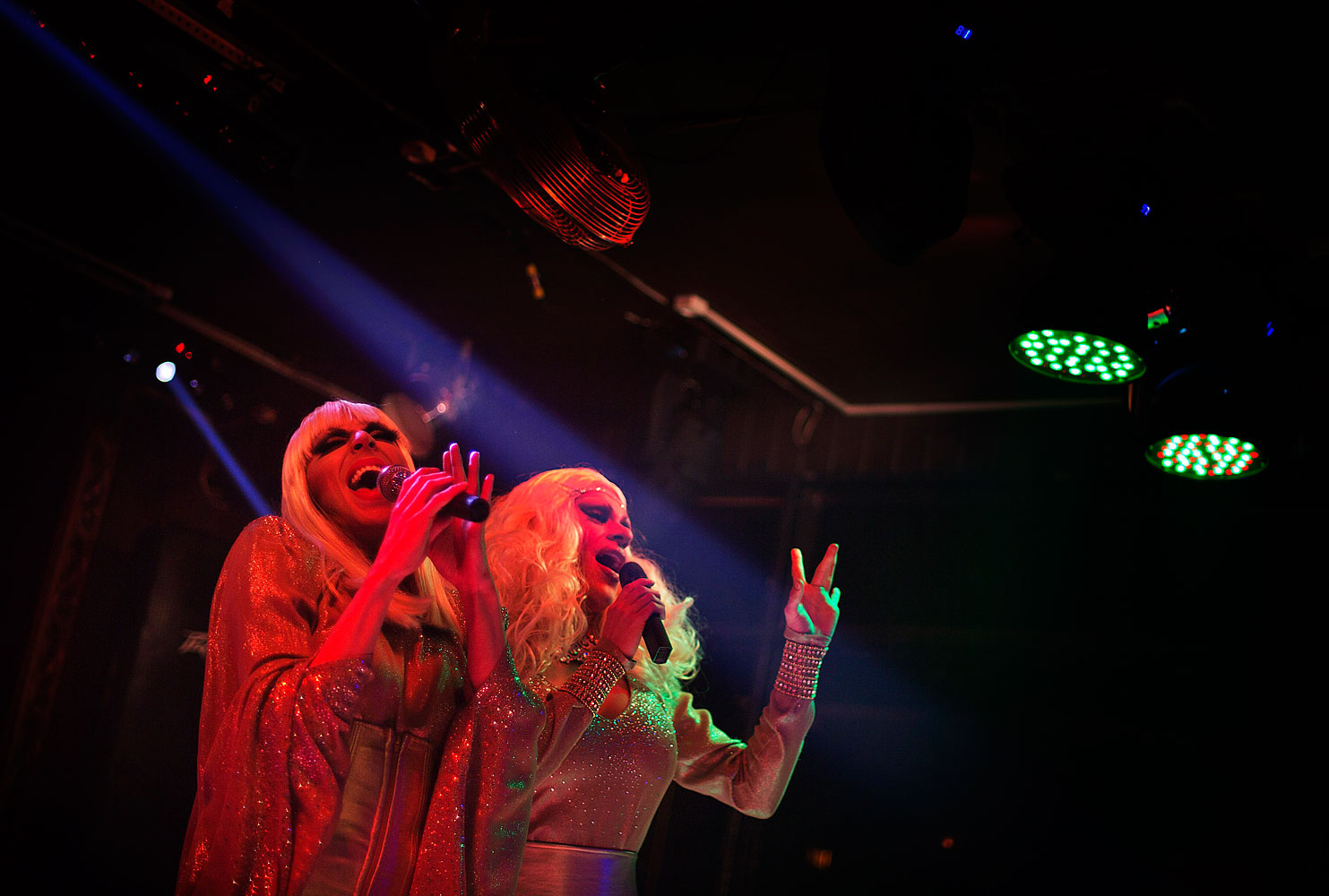 Kira, left, and Lisa, right, who would only give their stage names, perform during a show at the Mayak cabaret in Sochi, Feb. 8, 2014.