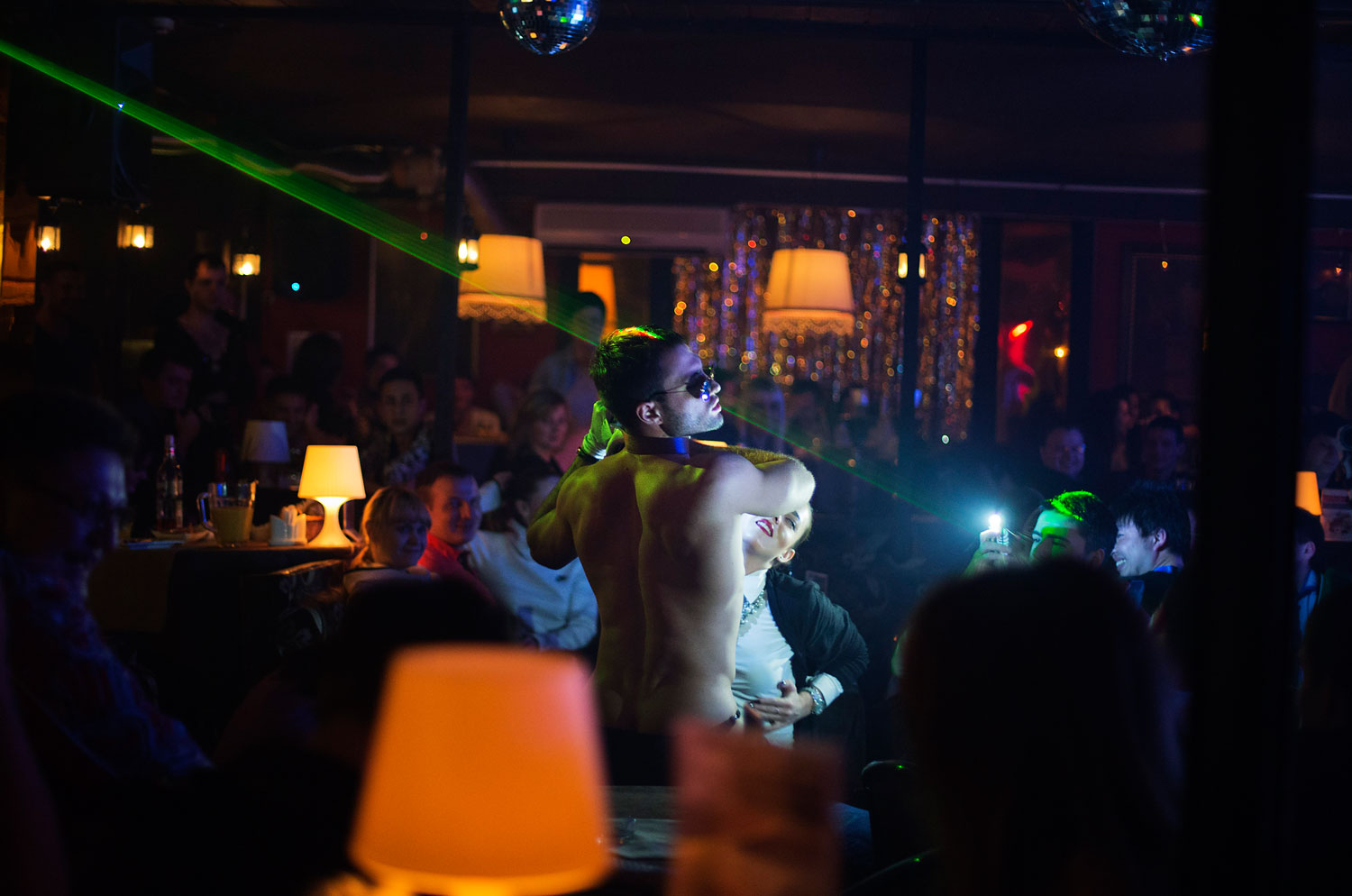 A dancer performs in the crowd at the Mayak cabaret in Sochi, Feb. 8, 2014.