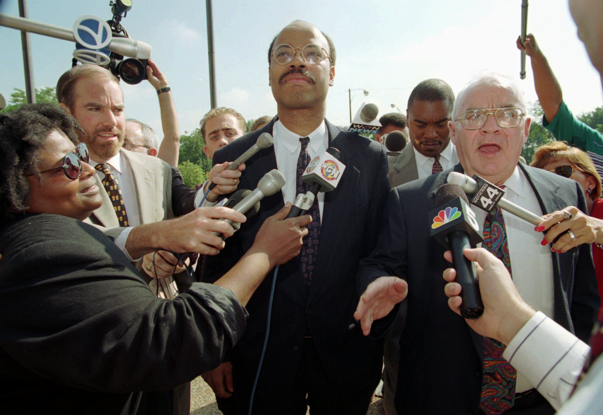 Congressman Mel Reynolds (center) and his attorney Sam Adam (right) walking to court in Chicago, Aug. 17, 1995, for the continuation of Reynold's sexual misconduct trial.