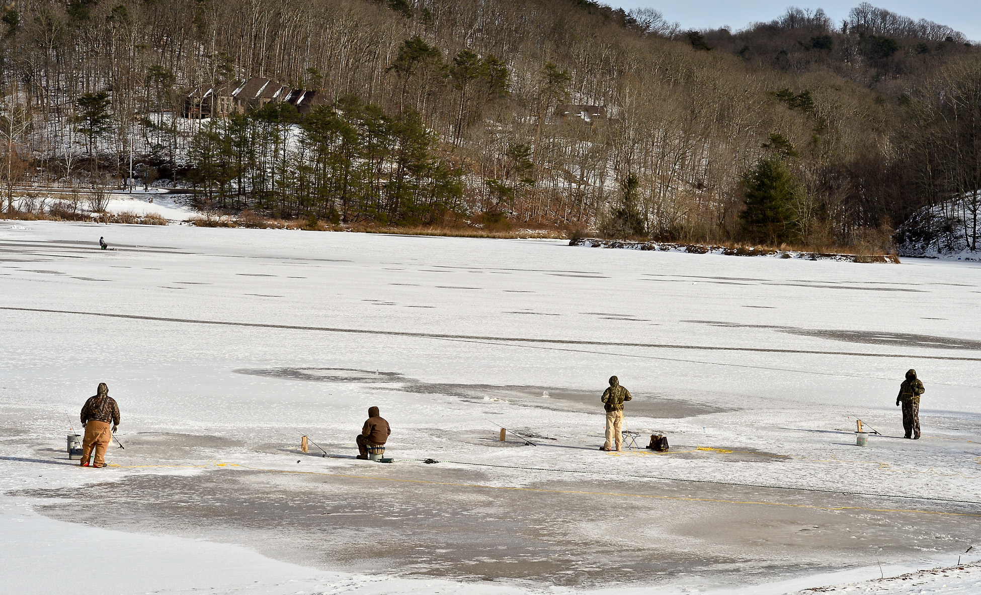 A group of ice fishers gather on the frozen surface of Ridenour Lake in Nitro, W.Va., Jan. 27, 2014.