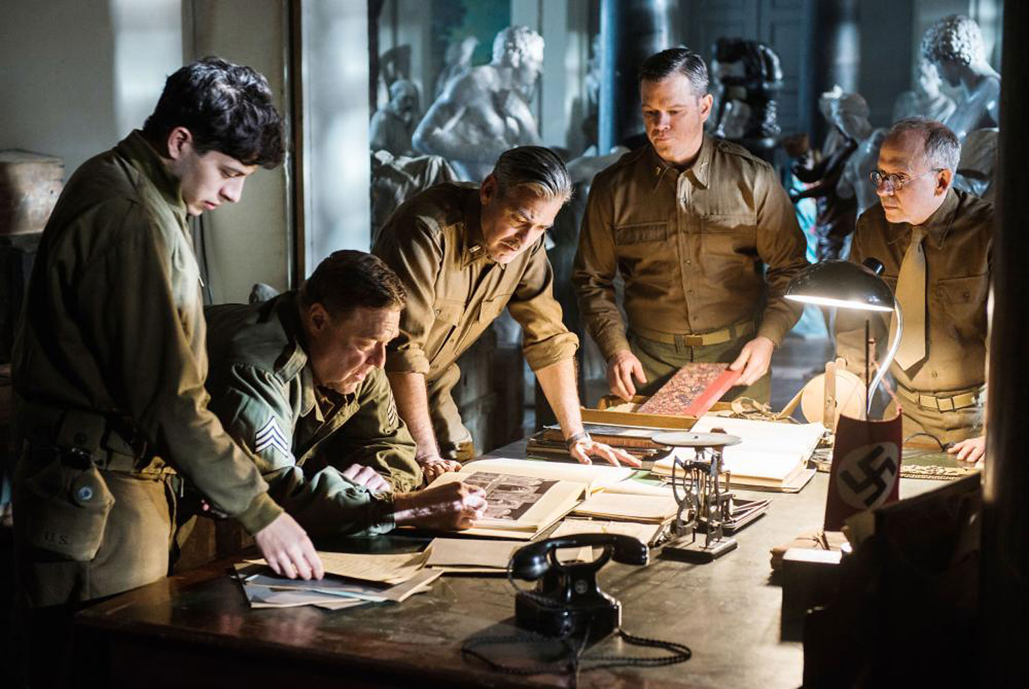 "George Clooney's newest film, Monuments Men, follows the exploits of an Allied platoon of seven ""Monuments Men"" who enter Germany during the end of World War II to rescue art stolen by the Nazis.                                           The movie is based off of the real life ""Monuments Men,  a group of more than 300 men and women from thirteen countries who worked together to protect and recover the stolen cultural artifacts. Their ranks ranged from museum directors to architects — and they would ultimately help return more than five million artistic and cultural items plundered by the Nazis."