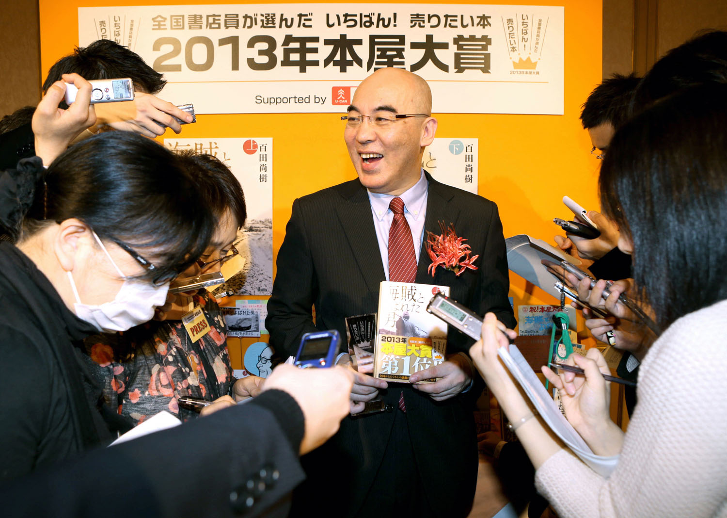 Writer and NHK board member Naoki Hyakuta, seen here last year at the launch of one of his books, believes the Japanese did not commit war crimes in World War II and that the U.S. fabricated them