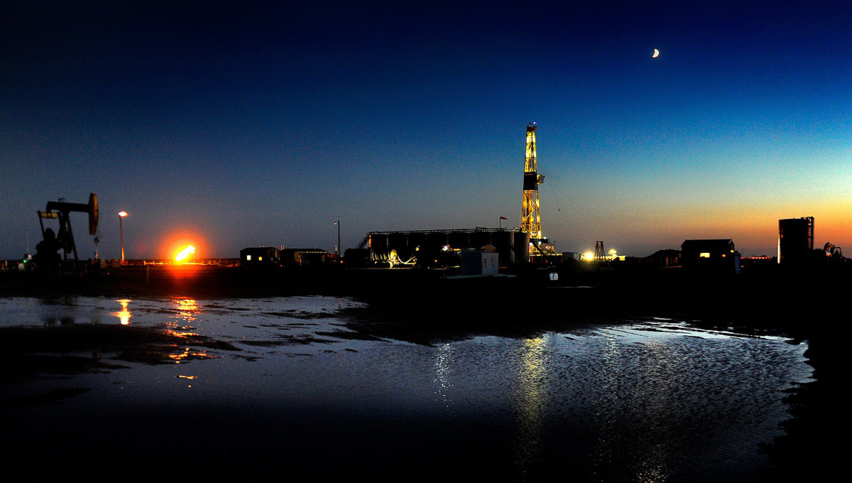 An oil drilling rig at dusk near New Town, North Dakota on June 29, 2012.