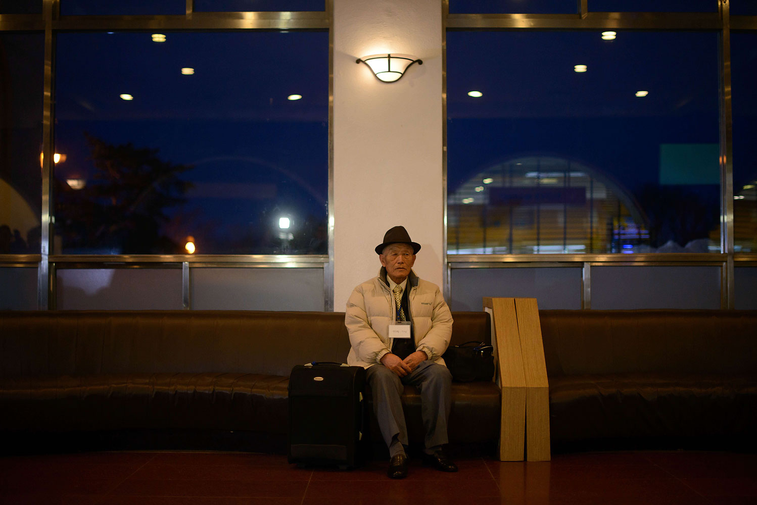 A South Korean man selected to attend joint North and South family reunions sits in the lobby of a hotel as he prepares to depart for the North Korean border, in the eastern port city of Sokcho on Feb. 20, 2014.