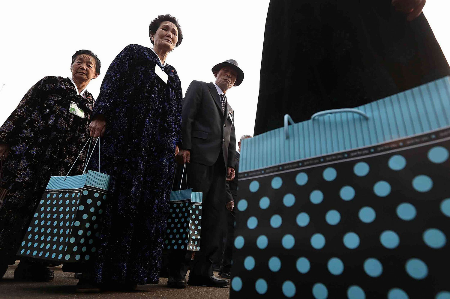 North Koreans carrying bags of presents for their South Korean family members wait in line to attend a luncheon during the Separated Family Reunion Meeting at the Mount Kumgang resort in North Korea, Feb. 24, 2014. ATTENTION EDITORS NO SALES. NO ARCHIVES. FOR EDITORIAL USE ONLY. NOT FOR SALE FOR MARKETING OR ADVERTISING CAMPAIGNS. THIS IMAGE HAS BEEN SUPPLIED BY A THIRD PARTY. IT IS DISTRIBUTED, EXACTLY AS RECEIVED BY REUTERS, AS A SERVICE TO CLIENTS. SOUTH KOREA OUT. NO COMMERCIAL OR EDITORIAL SALES IN SOUTH KOREA