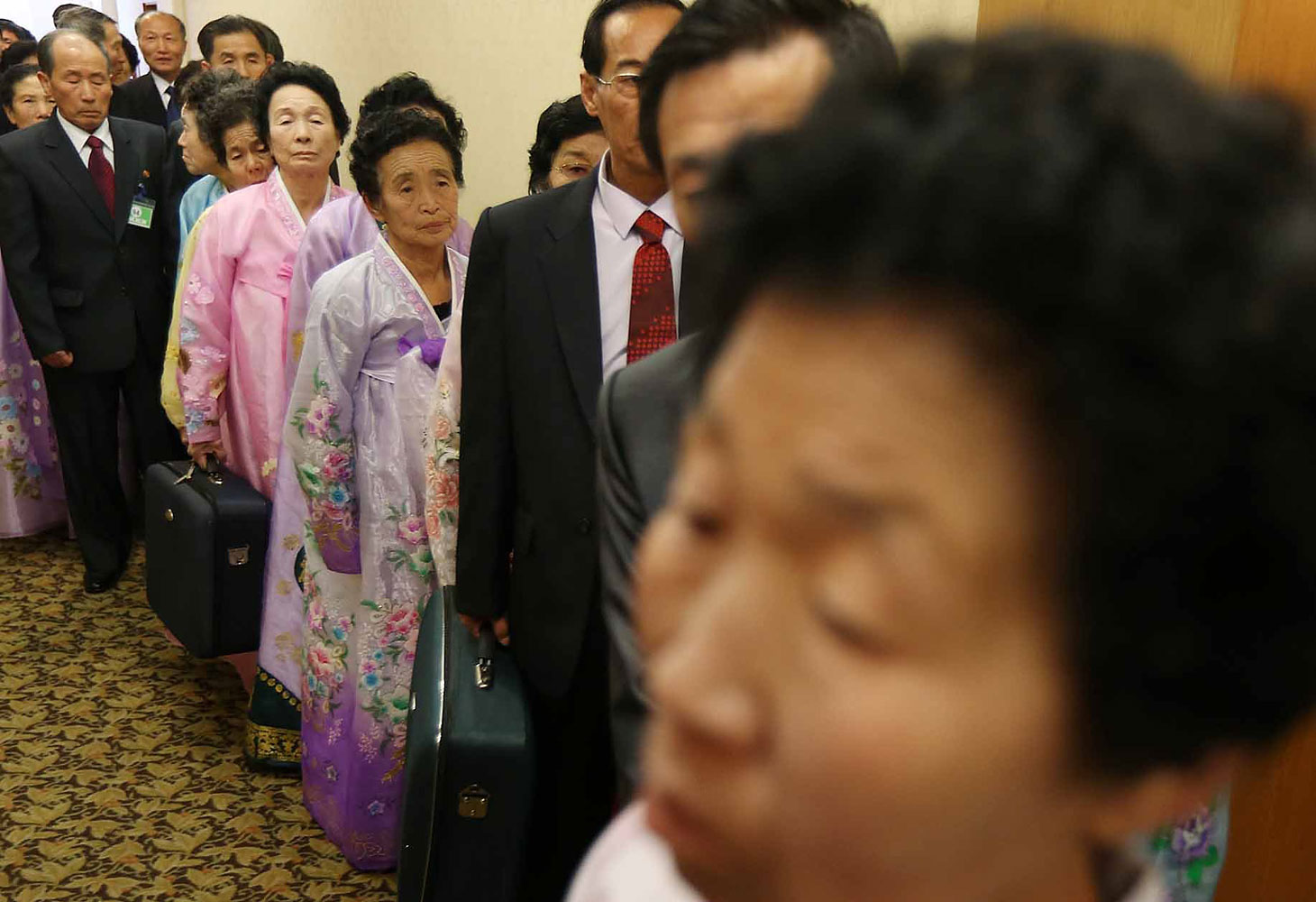 North Koreans arrive for private meetings with their South Korean relatives on the second day of family reunions between the divided countries, at a hotel in the North Korea resort of Mount Kumgang on Feb. 21, 2014.