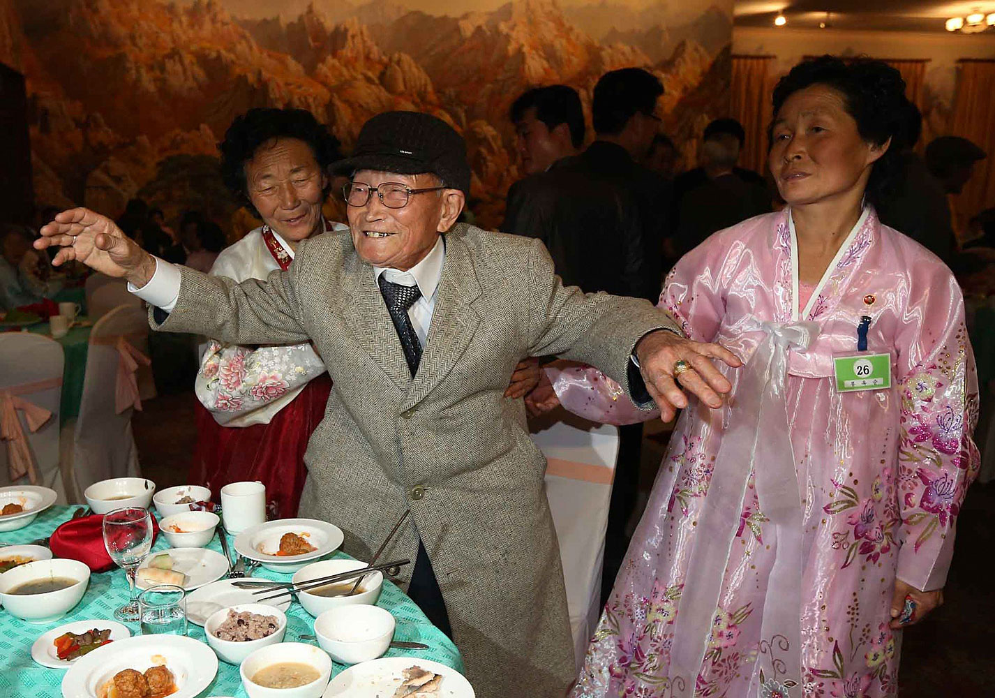 South Korean Yoo Youn-sik, 92, dances as he attends a welcome dinner with his North Korean family members during their family reunion at the Mount Kumgang resort in North Korea Feb. 20, 2014.