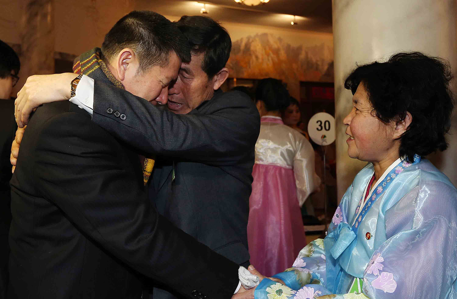 Park Yang-Kon of South Korea bids farewell to his brother Park Yang-Soo of North Korea as he prepares to depart the North Korean resort area of Mount Kumgang on the third and final day of the first group's family reunion on Feb. 22, 2014.