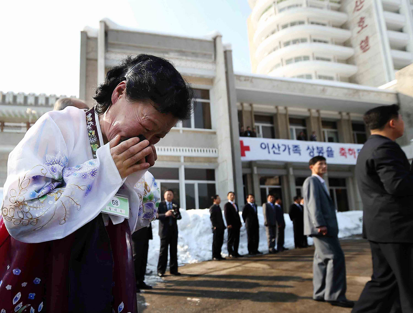 Lim Tae-Wook, a North Korean woman, sobs as she leaves her South Korean older brother after a separated family reunion meeting at Mount Kumgang resort, North Korea, Feb. 22, 2014.