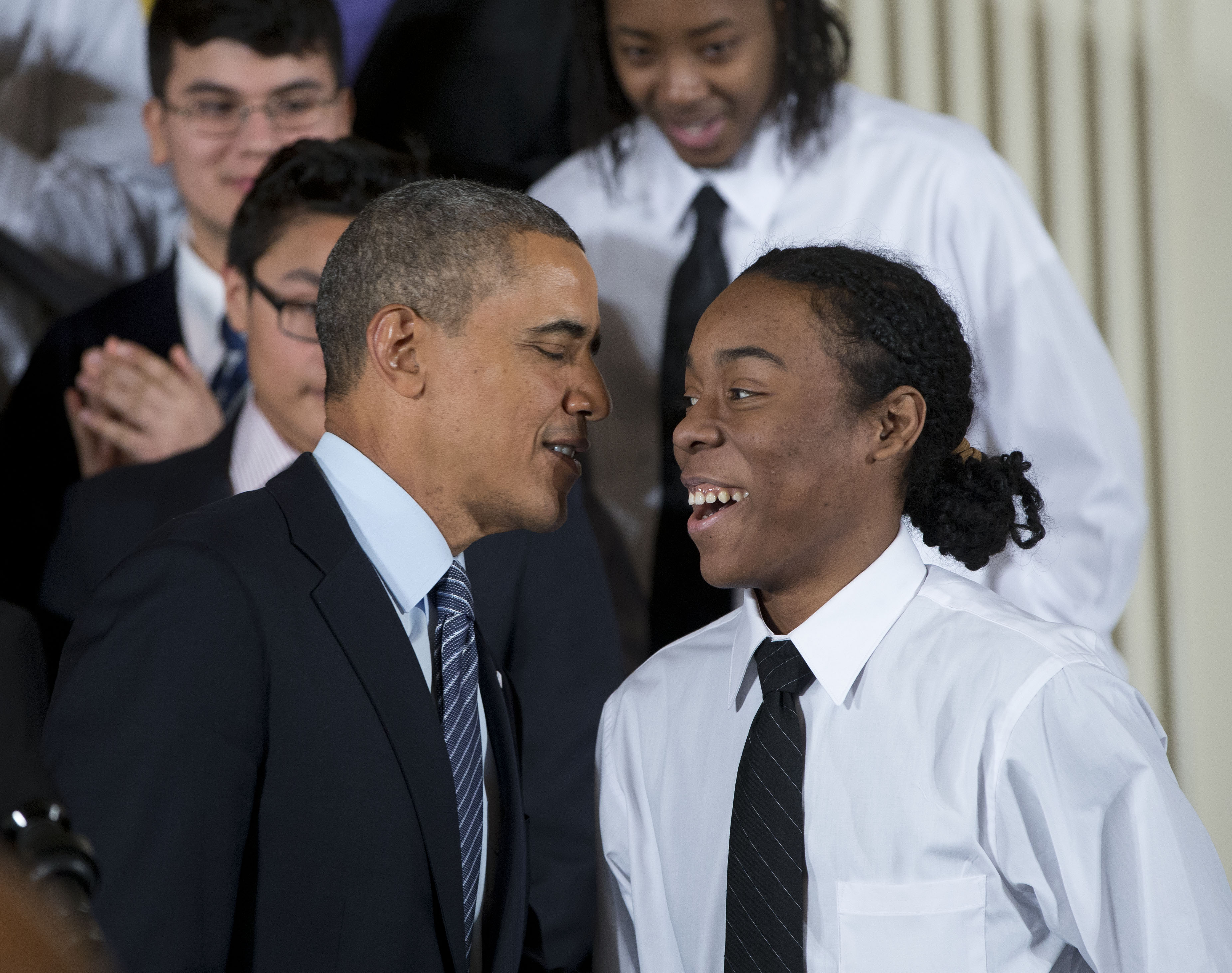 President Barack Obama speaks with Christian Champagne, 18, a senior at Hyde Park Career Academy in Chicago, who introduced him before launching a new initiative to provide greater opportunities for young black and Hispanic men called 'My Brother's Keeper' Thursday, Feb. 27, 2014, in the East Room of the White House in Washington.