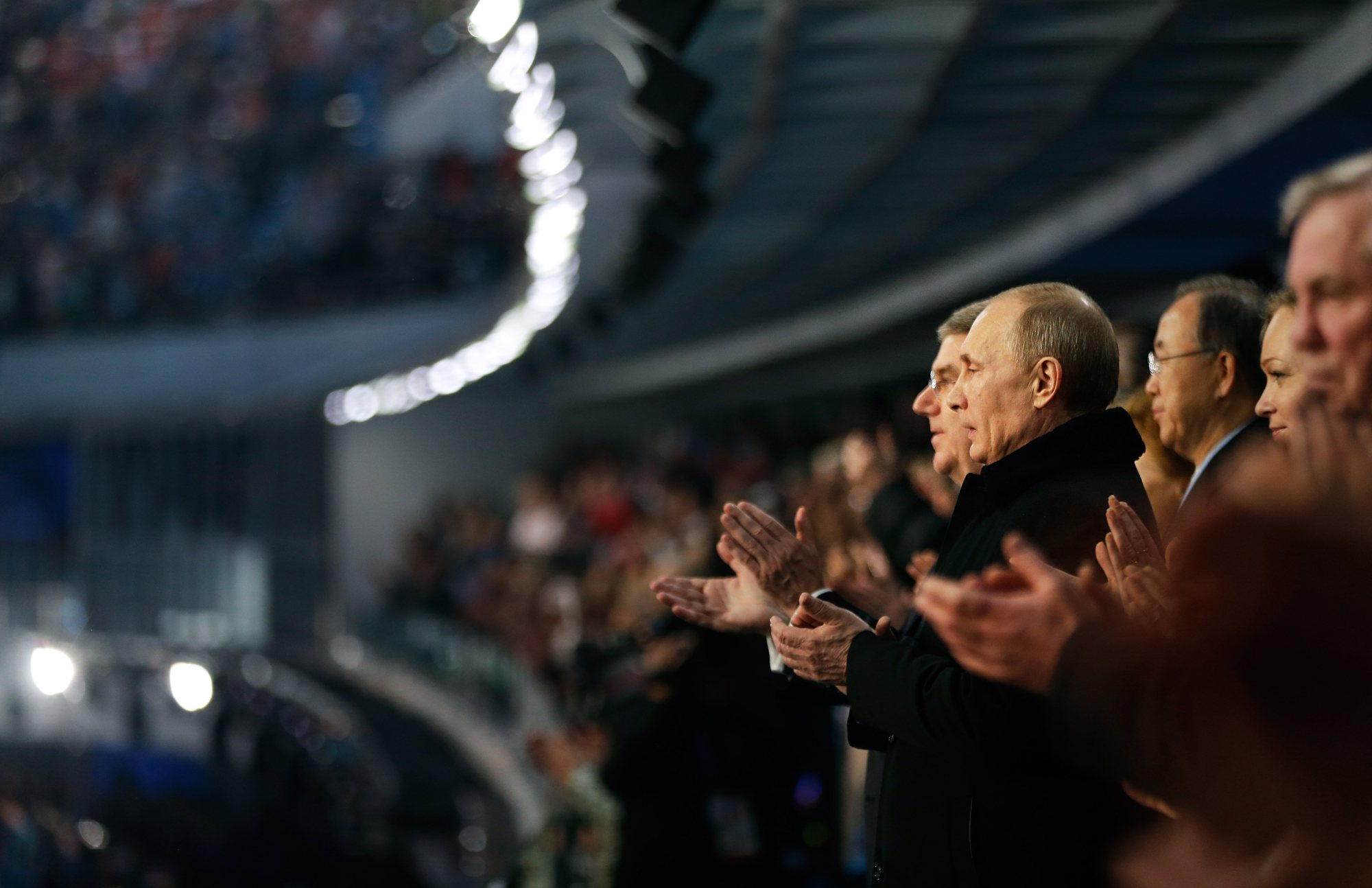 Russian President Vladimir Putin, right, and International Olympic Committee President Thomas Bach, left, applaud during the playing of the Russian national anthem.