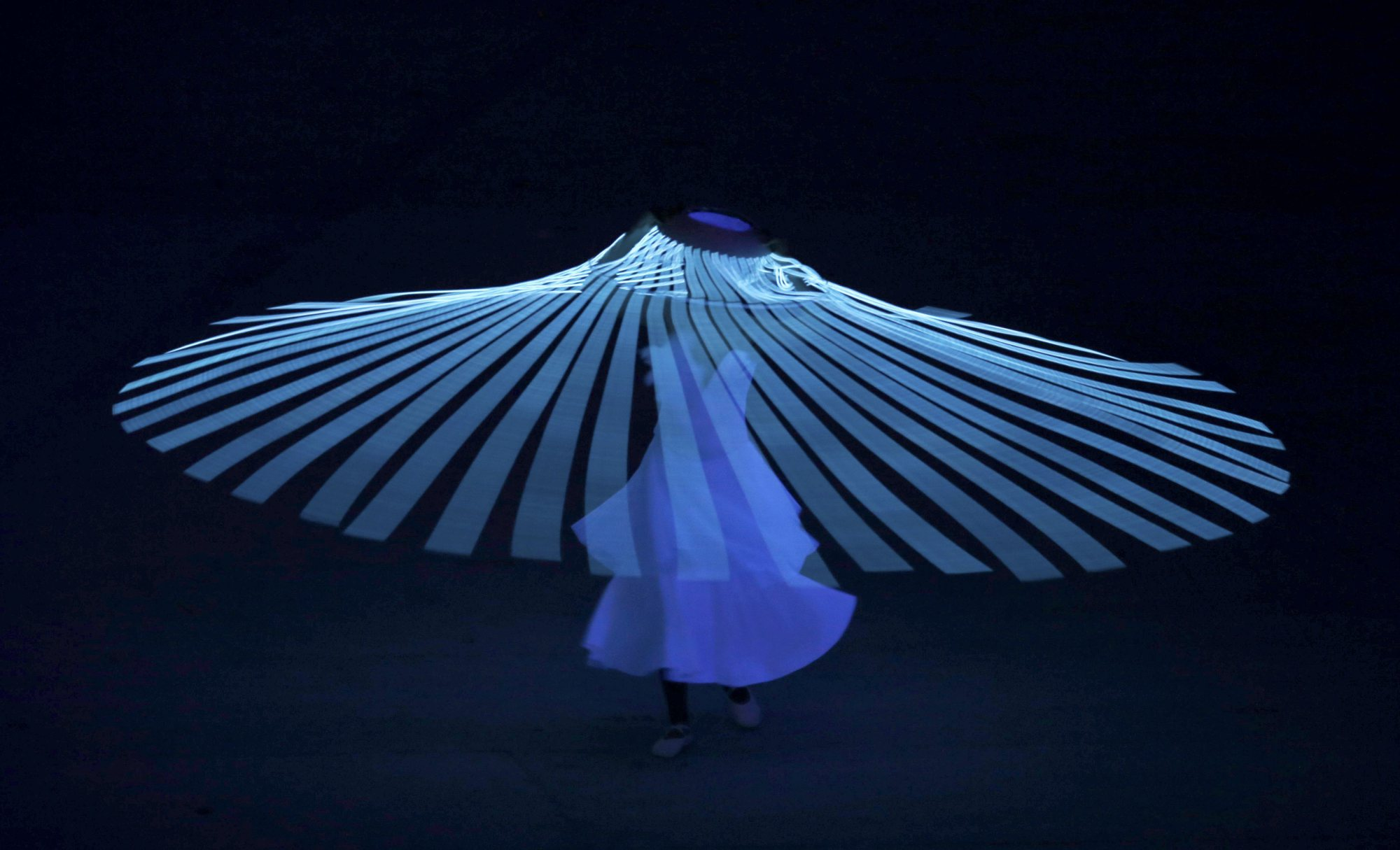 A performer dances during the opening ceremony.