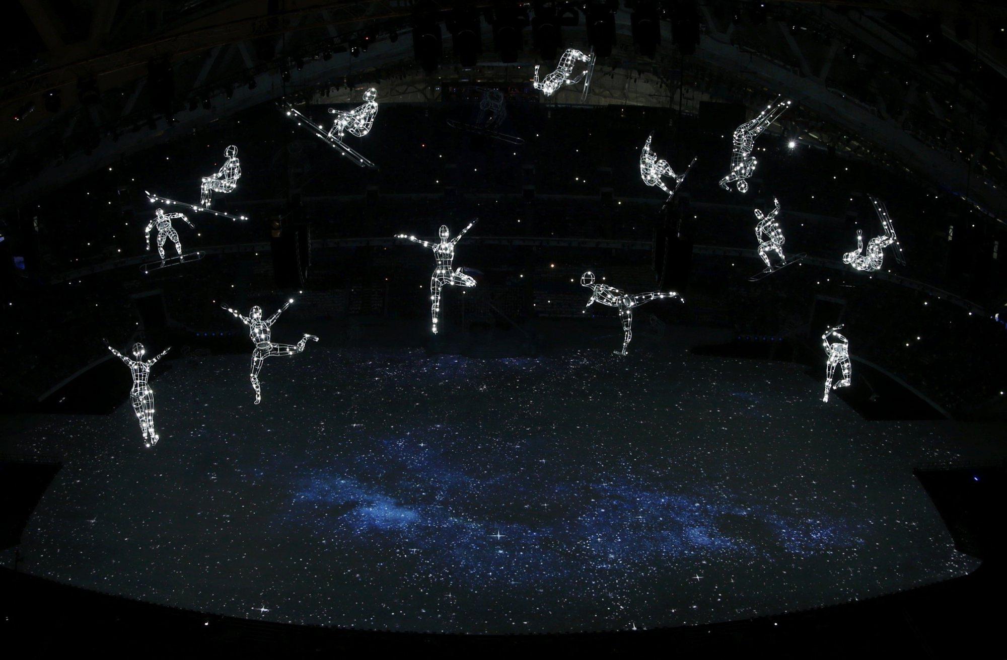 Suspended figures representing different winter sports illuminate.