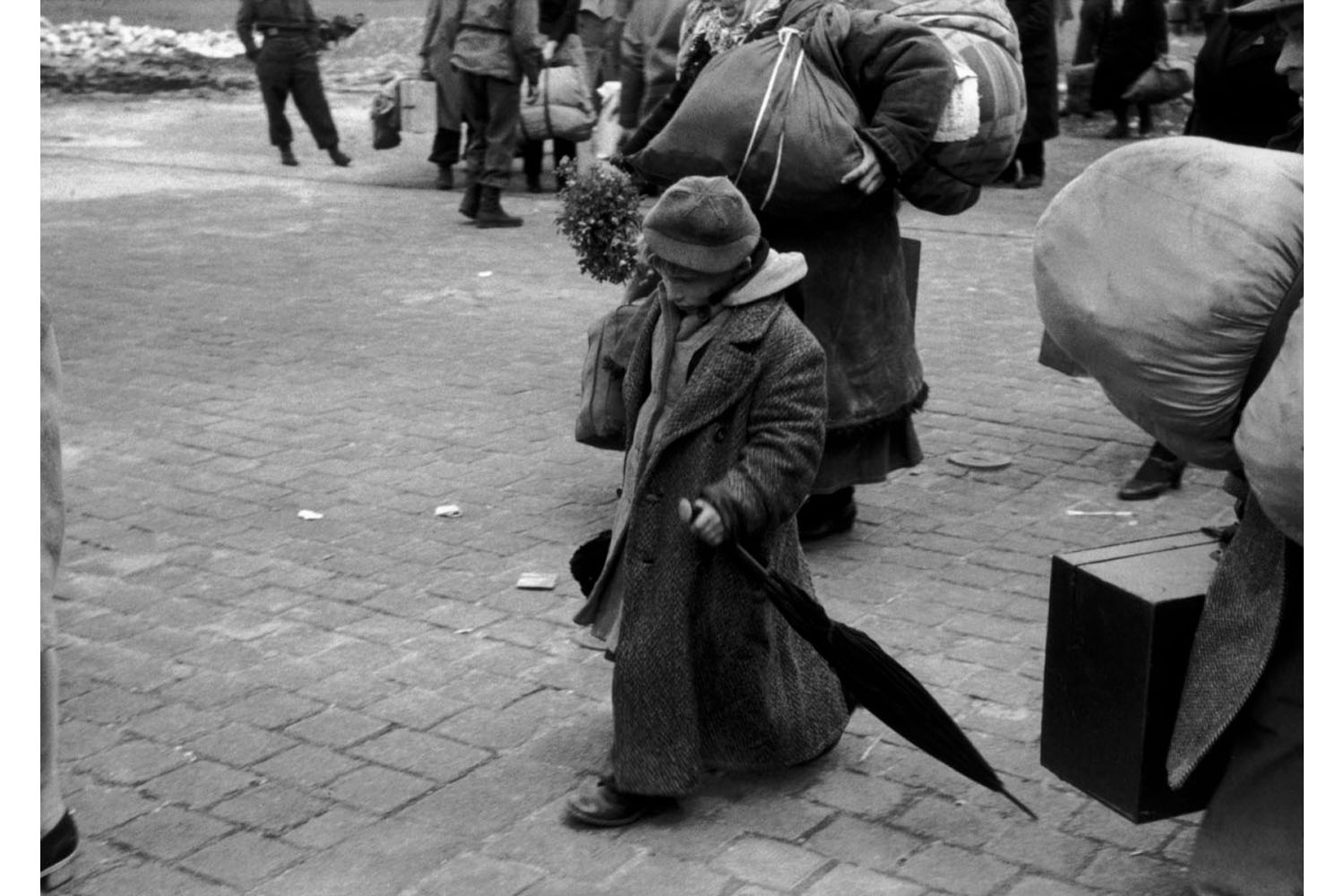 A Soviet child who was deported with his parents during the war at an Allied transit camp in Dessau, Germany, 1945.