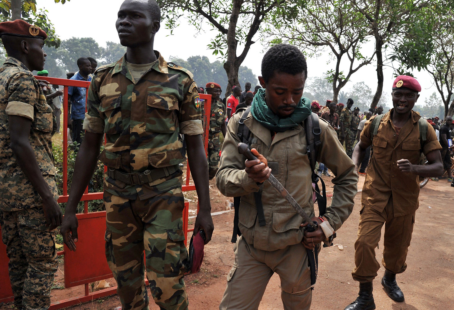 A member of the Central African Armed Forces puts his knife away after taking part in the lynching of a man suspected of being a former Seleka rebel on Feb. 5, 2014, in Bangui.