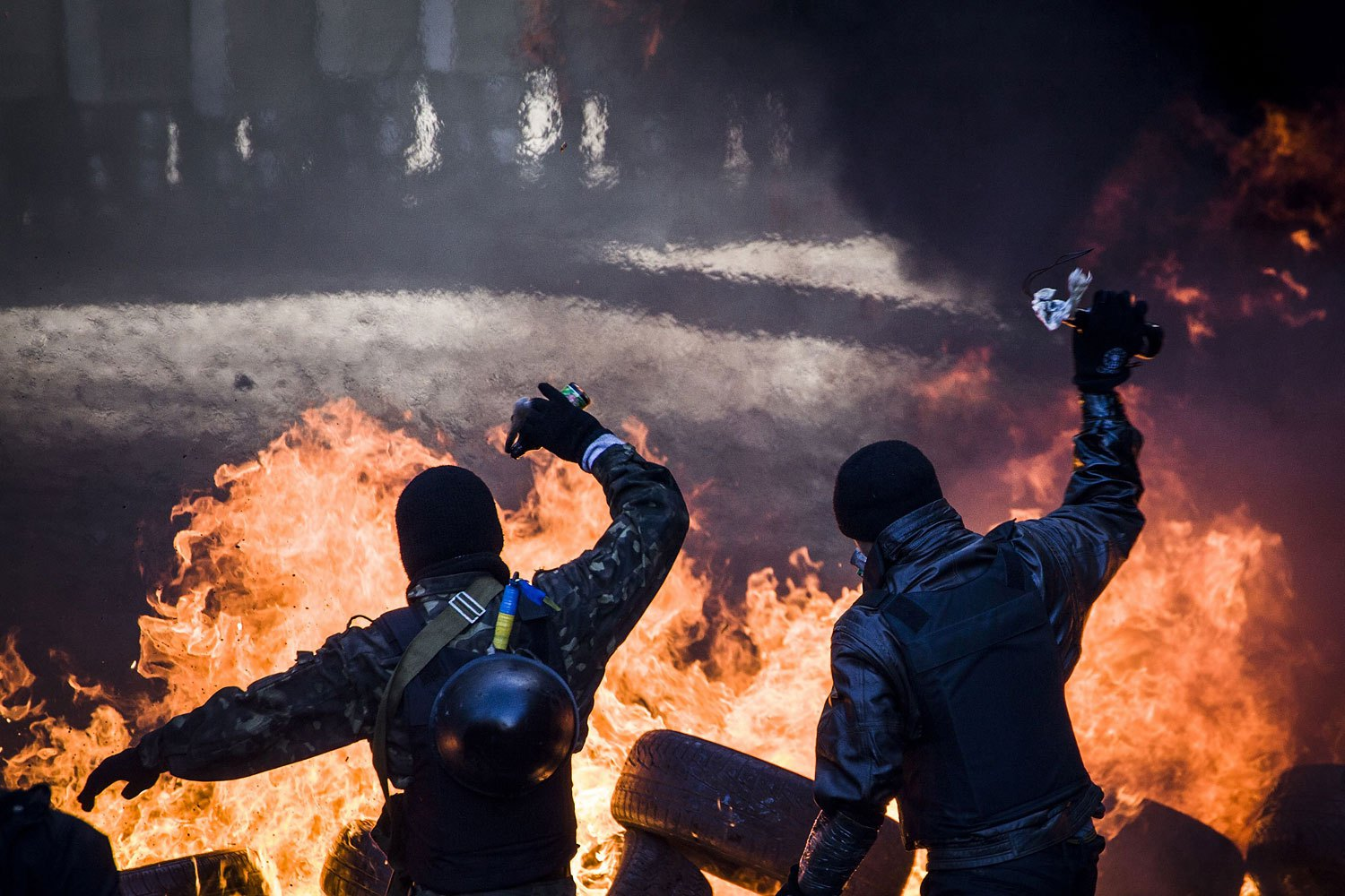 Anti-government demonstrators clash with riot police, Feb. 18, 2014.
