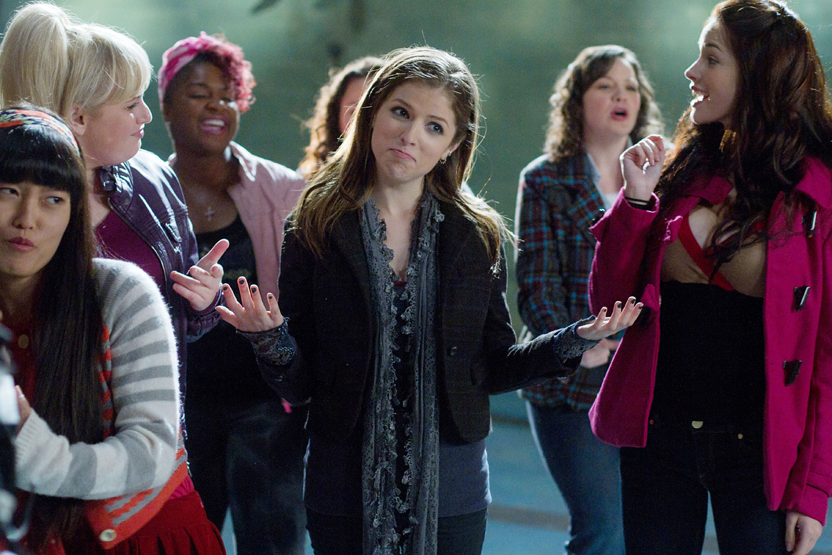 Hana Mae Lee (left), Rebel Wilson (blonde, left), Ester Dean (pink hair) and Anna Kendrick (center) in the hit a capella movie,  Pitch Perfect.