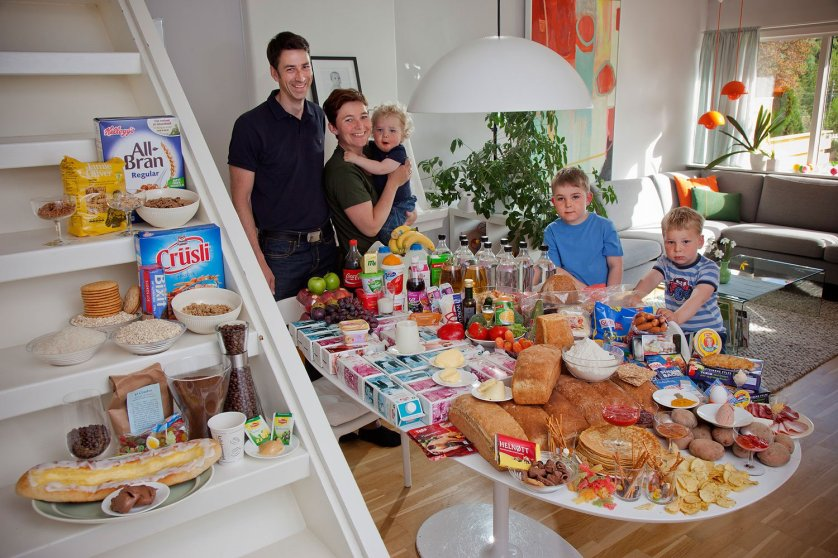 Valle Ottersland-Dahl Family. Gunhild Valle Ottersland, 45, her husband Tor Erik Dahn, 39, and their three children, Olav, 6 Hakon, 3, and Sverre, 1.5 of Gjettum, Norway, with their typical week's worth of food in June. Food expenditure for one week: 2211.97 Norwegian Kroner; $379.41 USD. Model-Released.