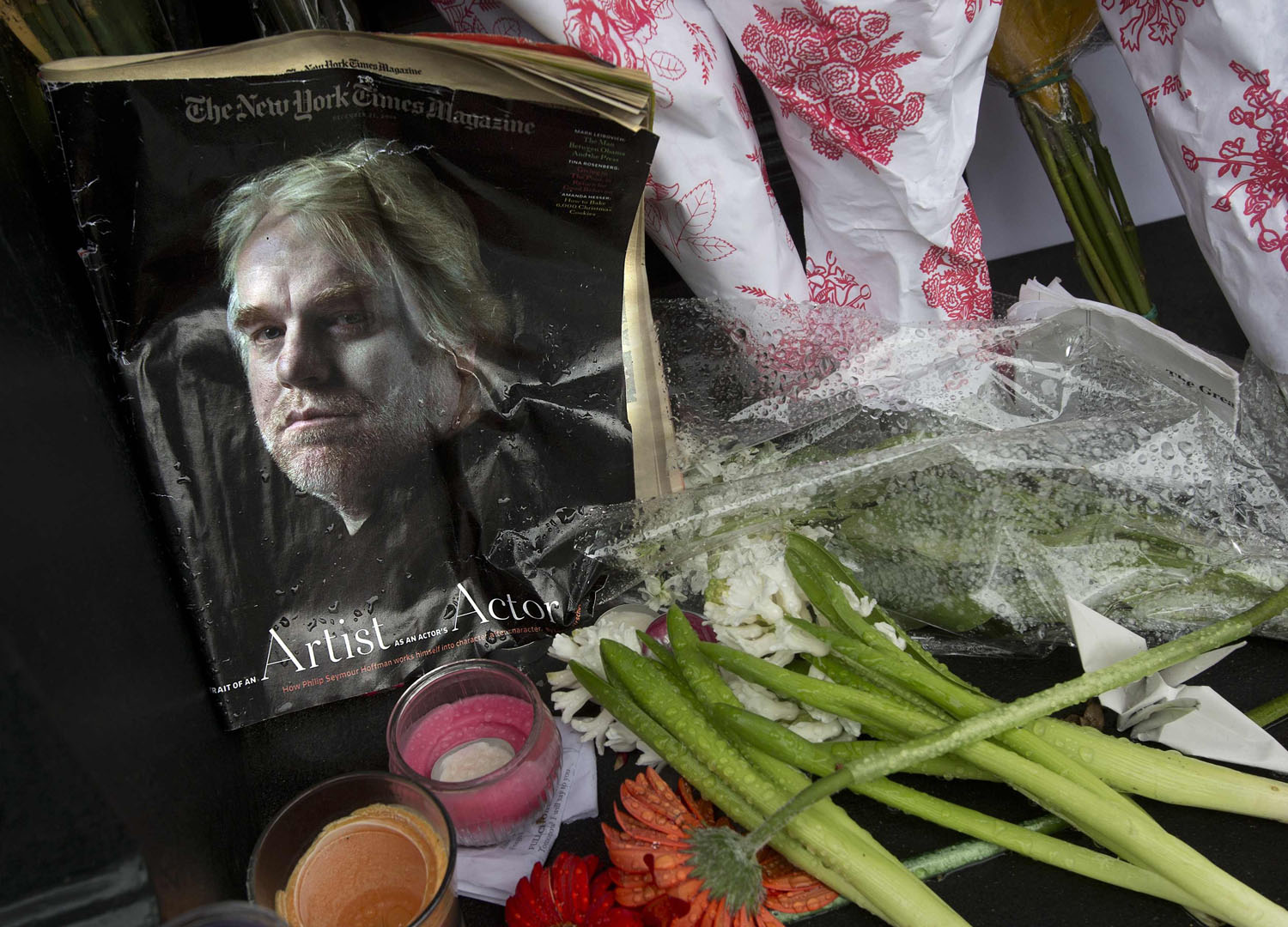 A copy of a New York Times Magazine with a photo of movie actor Philip Seymour Hoffman on the cover in a memorial in front of his apartment building in New York City, on Feb. 3, 2014.