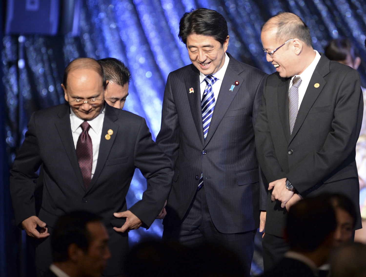 From left, Burma's President Thein Sein, Japan's Prime Minister Shinzo Abe and Philippine President Benigno Aquino III leave the stage during a gala dinner at the ASEAN-Japan Commemorative Summit meeting in Tokyo on Dec. 14, 2013