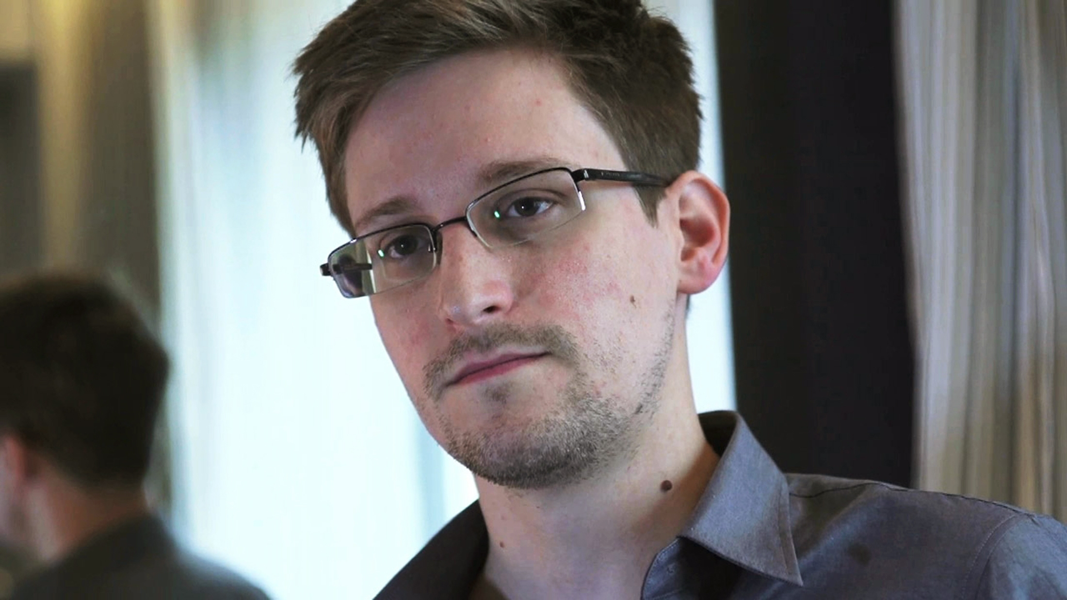 NSA whistle-blower Edward Snowden in a still image taken from video during an interview by the Guardian in his hotel room in Hong Kong on June 6, 2013