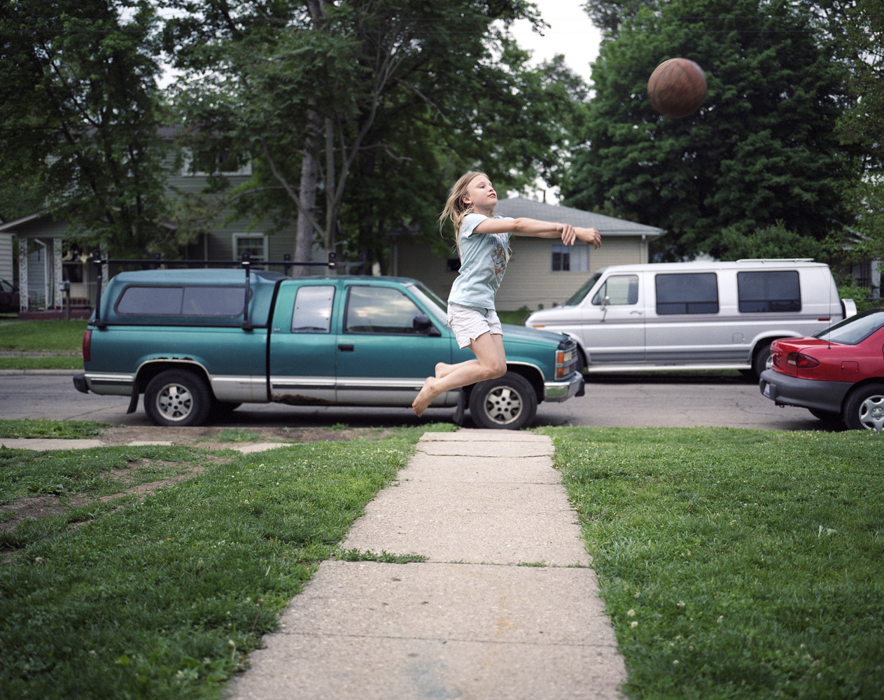 Playing basketball in the frontyard.  2009