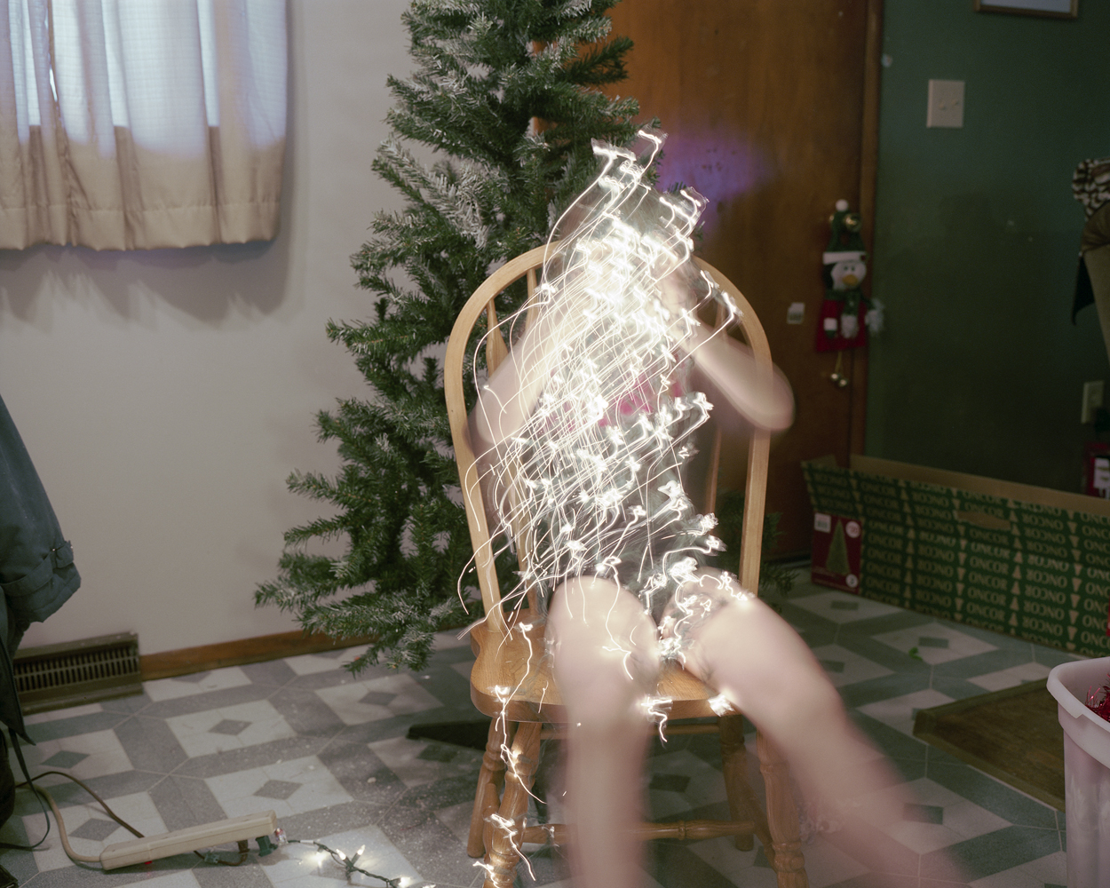 Mom thinks the Christmas lights look like something else.  2008