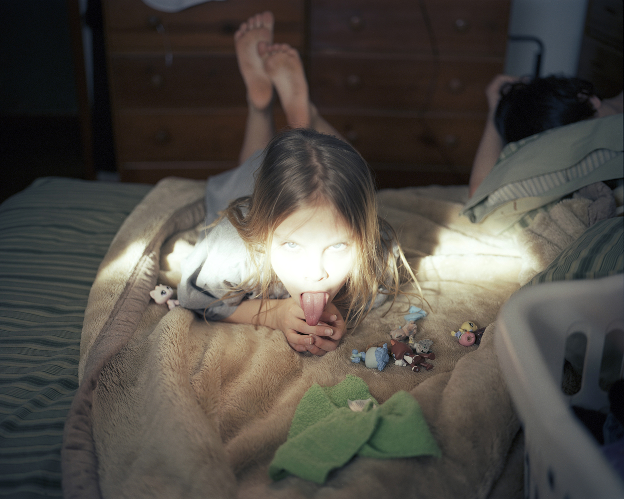 Erica with her toys and a sliver of sunshine.  2008