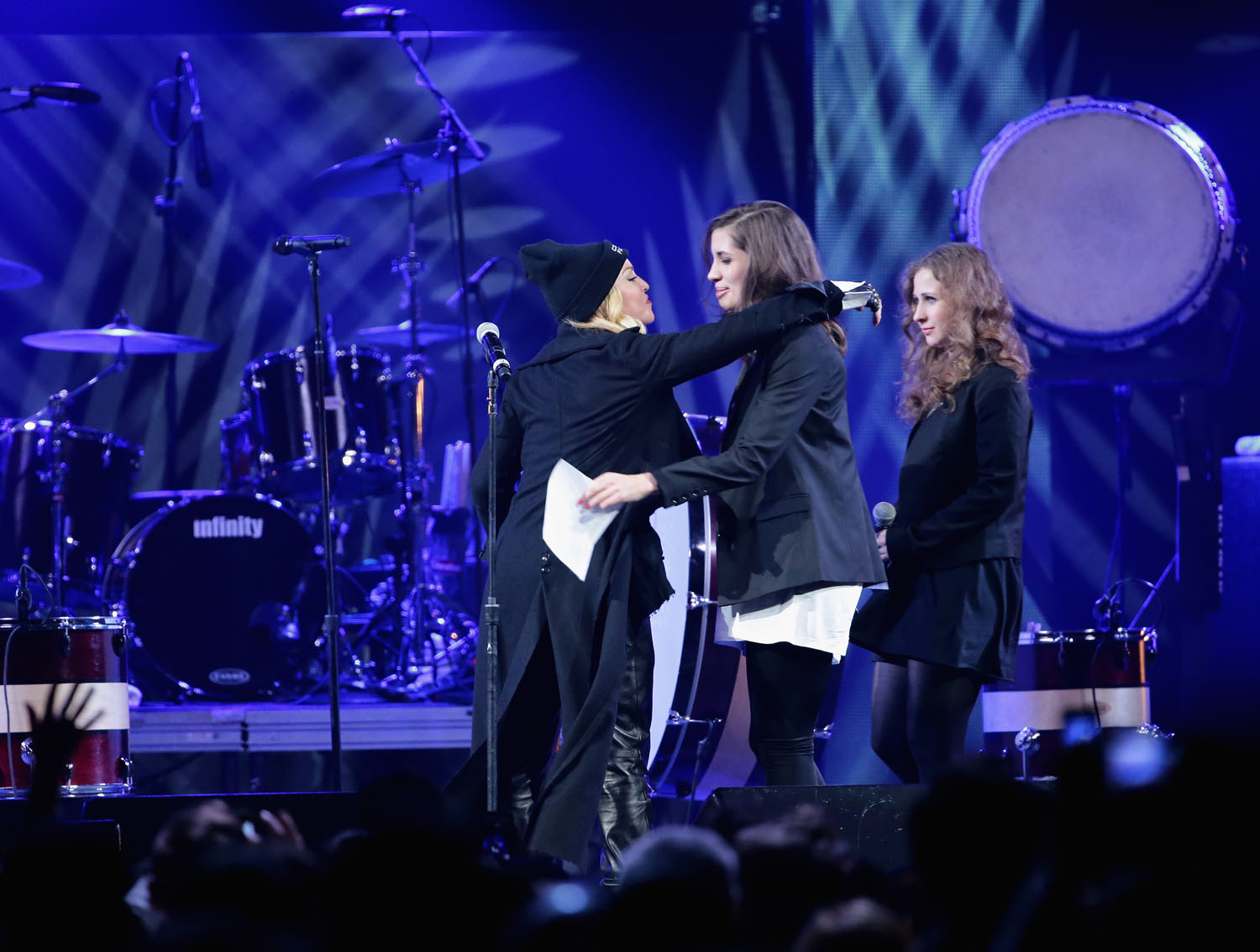 Madonna introduces Nadezhda Tolokonnikova, and Maria Alyokhina, formerly of Pussy Riot, onstage at the Amnesty International Concert presented by the CBGB Festival at Barclays Center on February 5, 2014 in New York City.