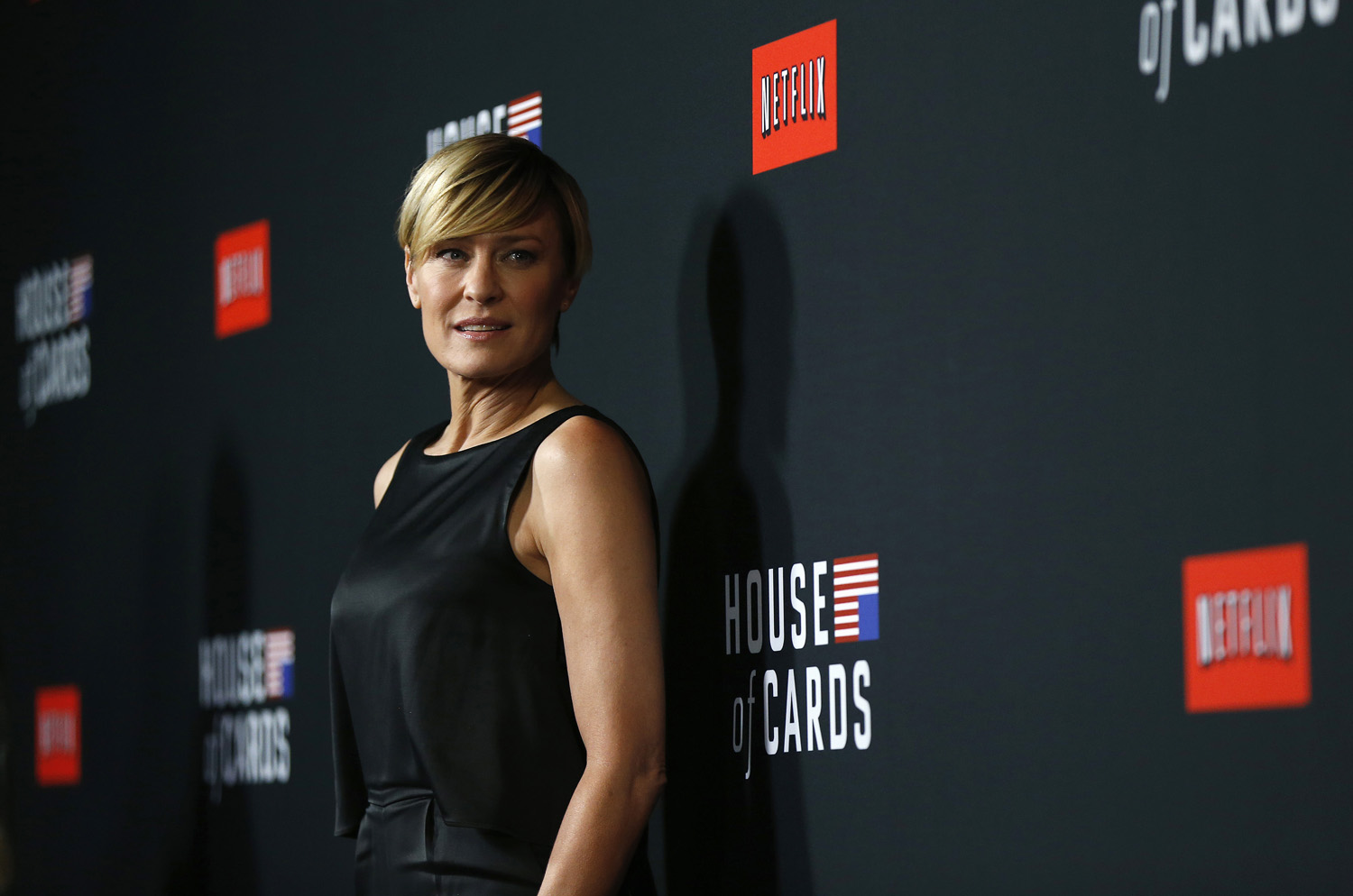 Cast member Robin Wright poses at the premiere for the second season of the television series  House of Cards  at the Directors Guild of America in Los Angeles, California February 13, 2014.