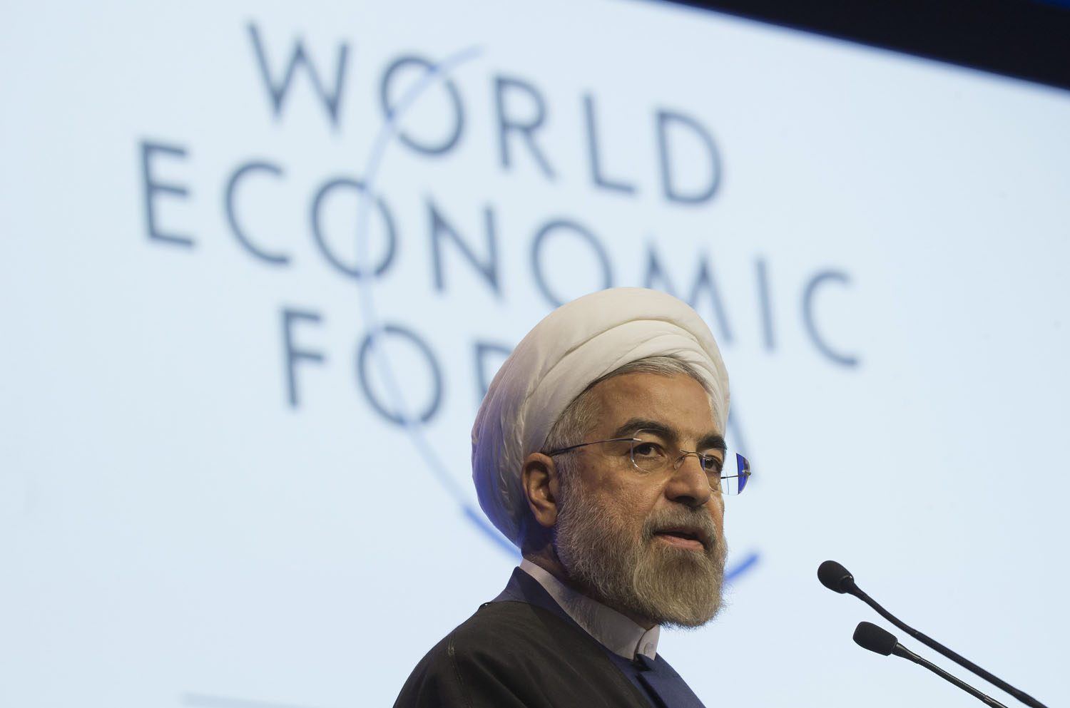Iranian President Hassan Rouhani, speaks during a session of the World Economic Forum in Davos, Switzerland, Jan. 23, 2014. Iran's economy is showing signs of recovery after a breakthrough in the negotiations over the country's nuclear program has allowed an easing of some economic sanctions.