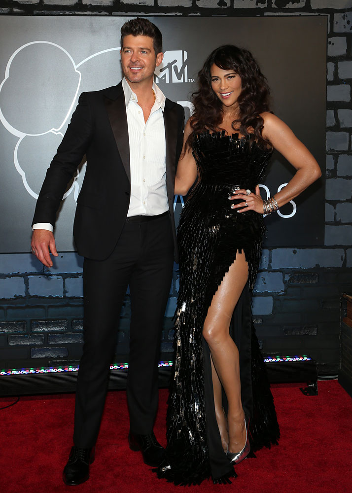 From left: Robin Thicke and his wife, actress Paula Patton, arrive at the 2013 MTV VMA Awards red carpet at the Barclay's Center in Brooklyn, N.Y., on Aug. 25, 2013.